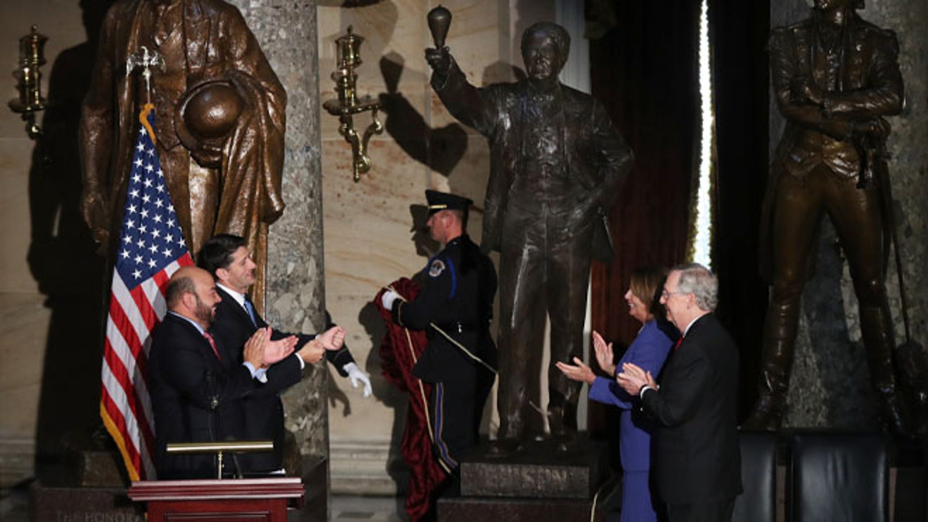 From left, Ohio House of Representatives Speaker Cliff Rosenberger, House Speaker Paul Ryan of Wis., House Minority Leader Nancy Pelosi of Calif., and Senate Majority Leader Mitch McConnell of Ky., applaud during the unveiling of the statue of Thomas Edison in Statuary Hall on Capitol Hill in Washington, Wednesday, Sept. 21, 2016. (AP Photo/Manuel Balce Ceneta)