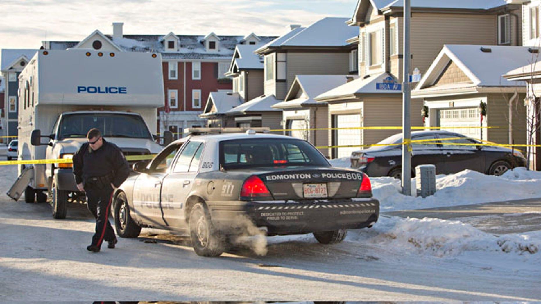 Dec. 30, 2014: Police investigate the scene where multiple deaths occurred overnight in Edmonton, Alberta. (AP)
