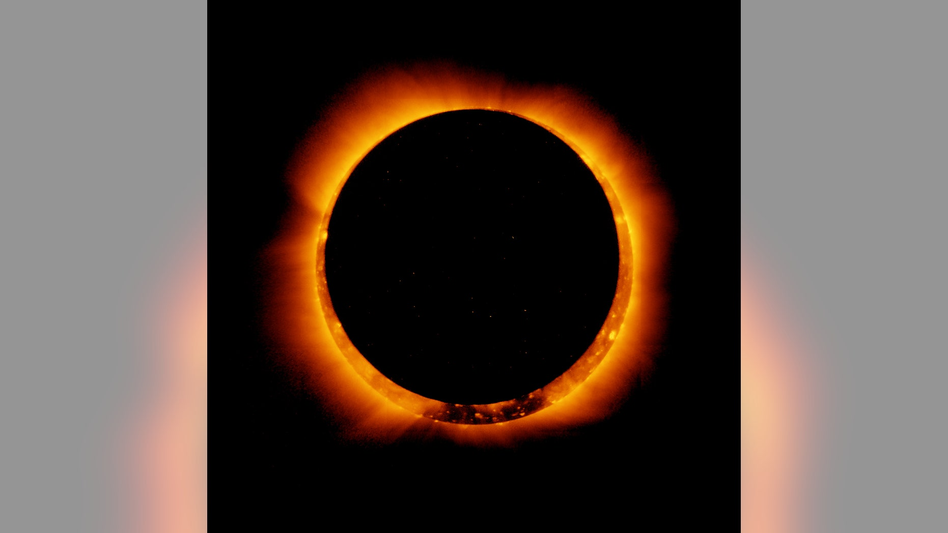 Eclipse models suggest that the sun's photosphere is slightly larger than the value commonly used. Eclipse measurements could help determine for sure. Here, an annular eclipse is visible.