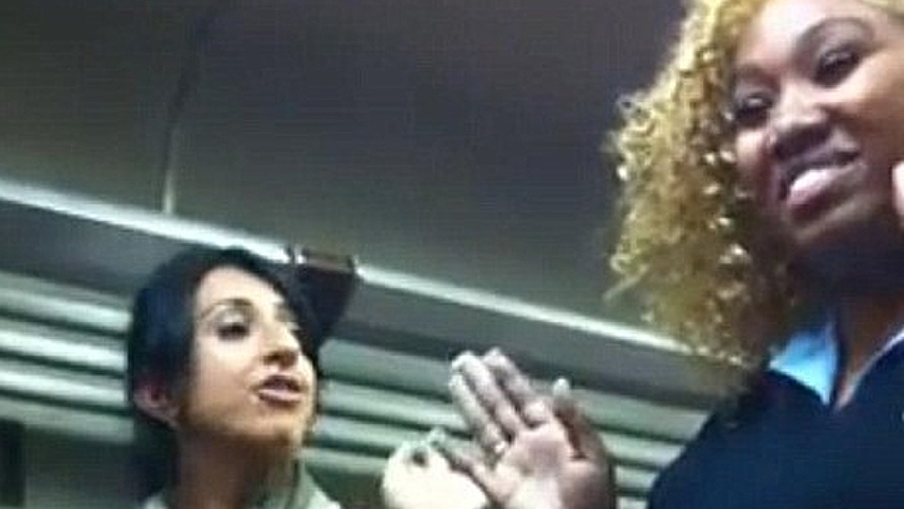 An undated, 2-minute YouTube video with more than 350,000 views as of early Friday depicts an unidentified woman, left, talking loudly as she is approached by a female conductor aboard a Metro-North train in New York. (YouTube.com)