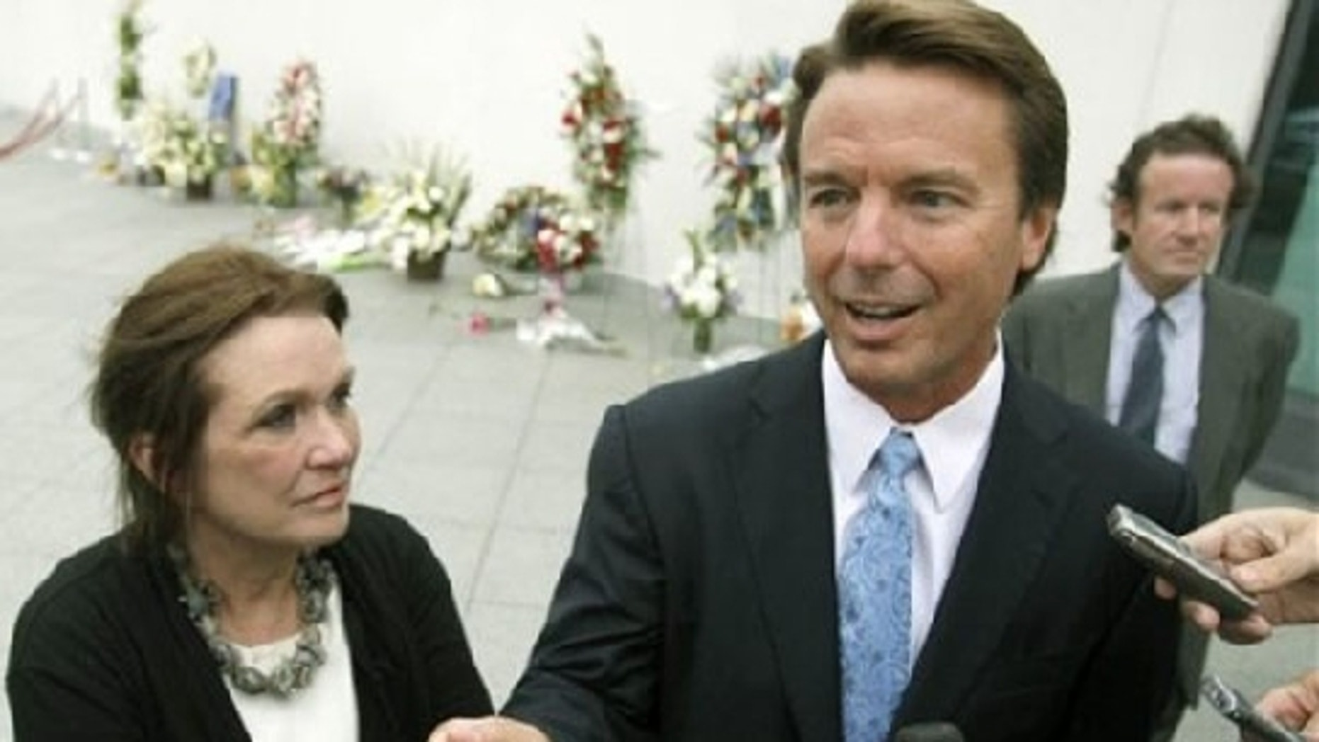 Aug. 28, 2009: Speaking of standing by her man, Elizabeth Edwards joins former Sen. John Edwards at a memorial service in Boston for the late Sen. Edward Kennedy. (AP Photo)