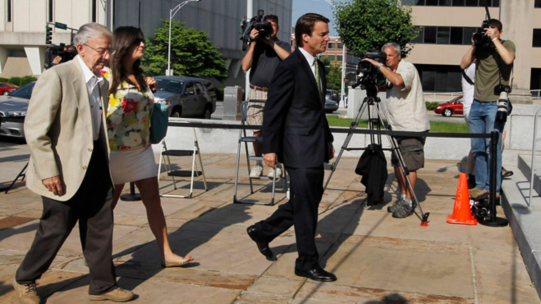May 2, 2012: John Edwards, right, walks with his father Wallace and daughter Cate into the Federal Courthouse in Greensboro, N.C.