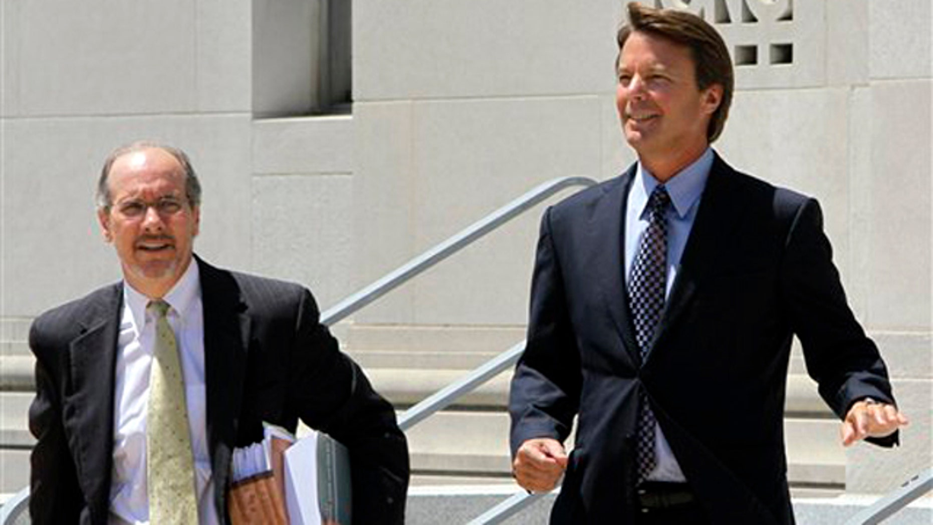 Former presidential candidate John Edwards, right, leaves federal court with attorney Jim Cooney following an appearance in Greensboro, N.C., Thursday, July 14, 2011.