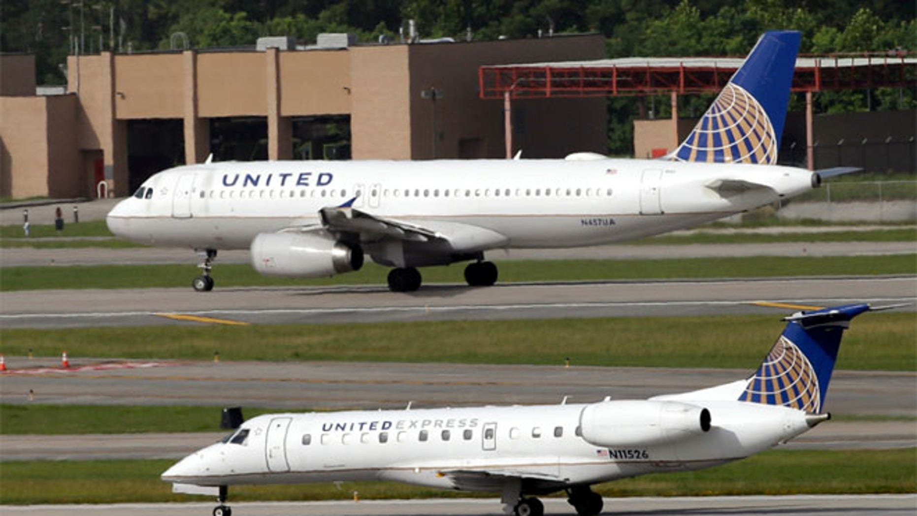 FILE: United Airlines planes seen at the George Bush International Airport in Houston, Texas.