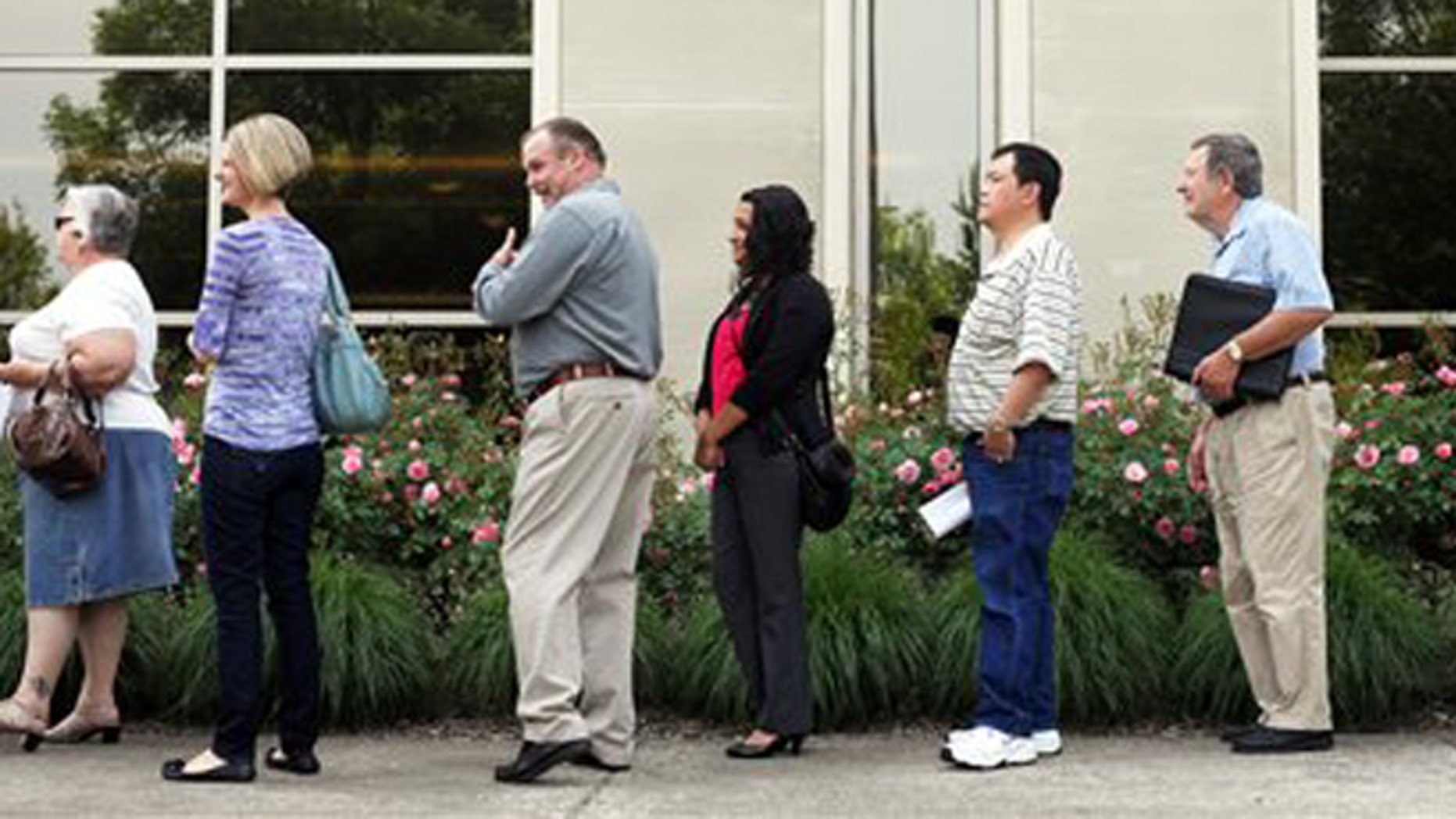 May 30, 2012: Dozens of people line up to seek a job at the Wells Fargo call center in Salem, Ore.