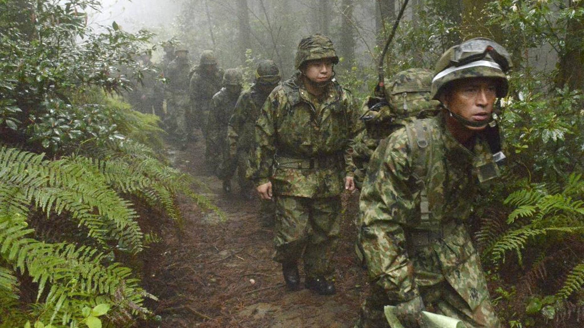 Members of the Japan Self-Defense Forces resume a search operation for a disapeared Japanese military jet carrying six airmen, in Kanoya city, Kagoshima prefecture, southern Japan, Thursday, April 7, 2016. The military jet carrying six airmen disappeared from radar over southern Japan on Wednesday afternoon, and the search has been suspended for the night. The plane disappeared about an hour after takeoff from Kanoya base for what was supposed to be a three-hour flight, the Defense Ministry said. (Sadayuki Goto/Kyodo News via AP) JAPAN OUT, CREDIT MANDATORY