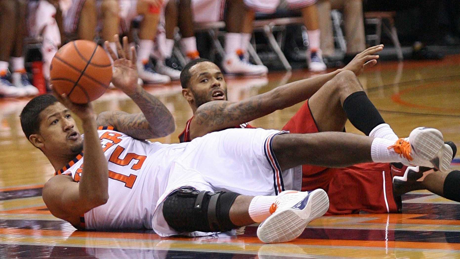 UTEP's Malcolm Moore dives for a loose ball against Nebraska's Ray Gallegos during an NCAA college basketball game Sunday Dec. 23, 2012, in the championship game of the WestStar Bank Don Haskins Sun Bowl Invitational at the Don Haskins Center in El Paso, Texas.  (AP Photo/El Paso Times, Mark Lambie)