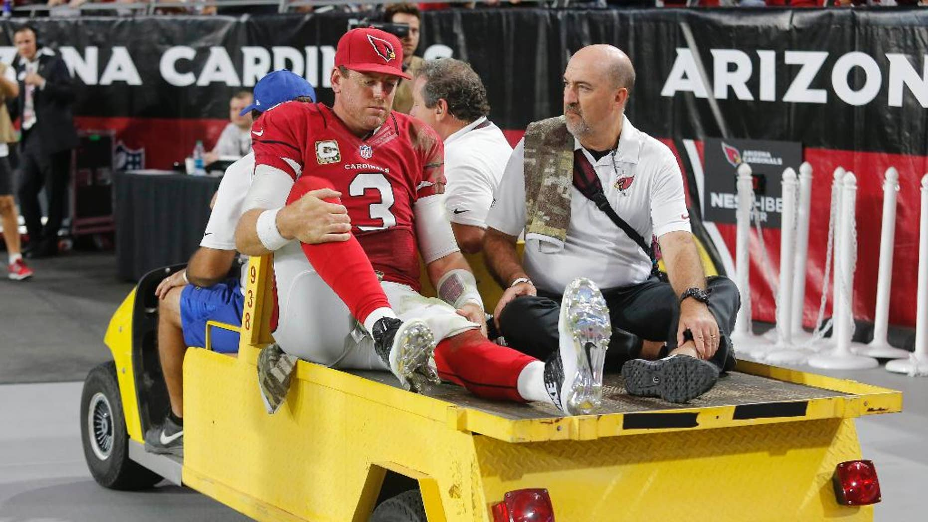 Arizona Cardinals quarterback Carson Palmer (3) leaves the NFL football game against the St. Louis Rams after an injury during the second half, Sunday, Nov. 9, 2014, in Glendale, Ariz. (AP Photo/Rick Scuteri)