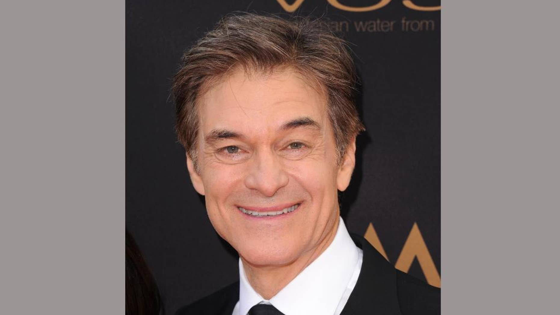 FILE - In this May 1, 2016 file photo, Dr. Mehmet Oz arrives at the 43rd annual Daytime Emmy Awards in Los Angeles. Oz is partner in a new venture called JungoTV, announced Monday, June 6, that will attempt to give immigrants online access to popular television programs from their home countries. (Photo by Richard Shotwell/Invision/AP, File)