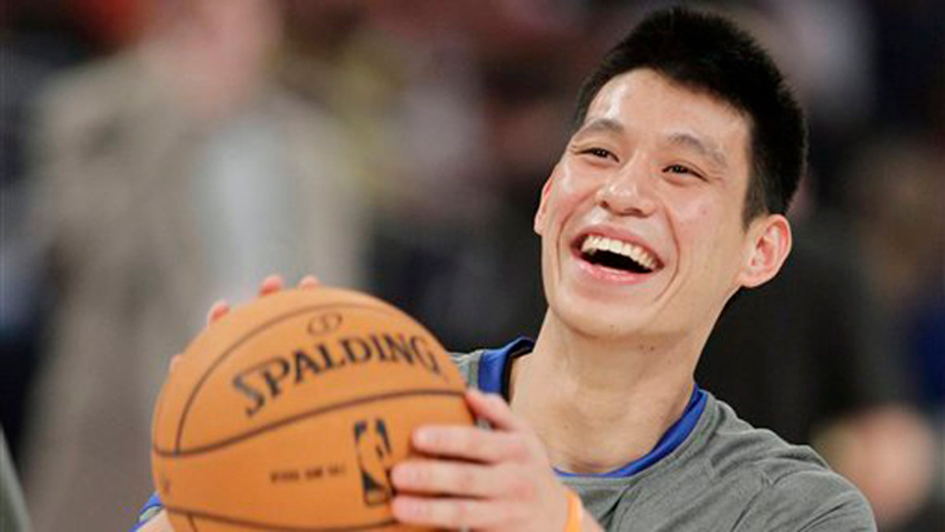 Feb. 24, 2012: This file photo shows New York Knicks' Jeremy Lin laughing during warmups before the start of the NBA All-Star Rising Stars Challenge basketball game in Orlando, Fla.
