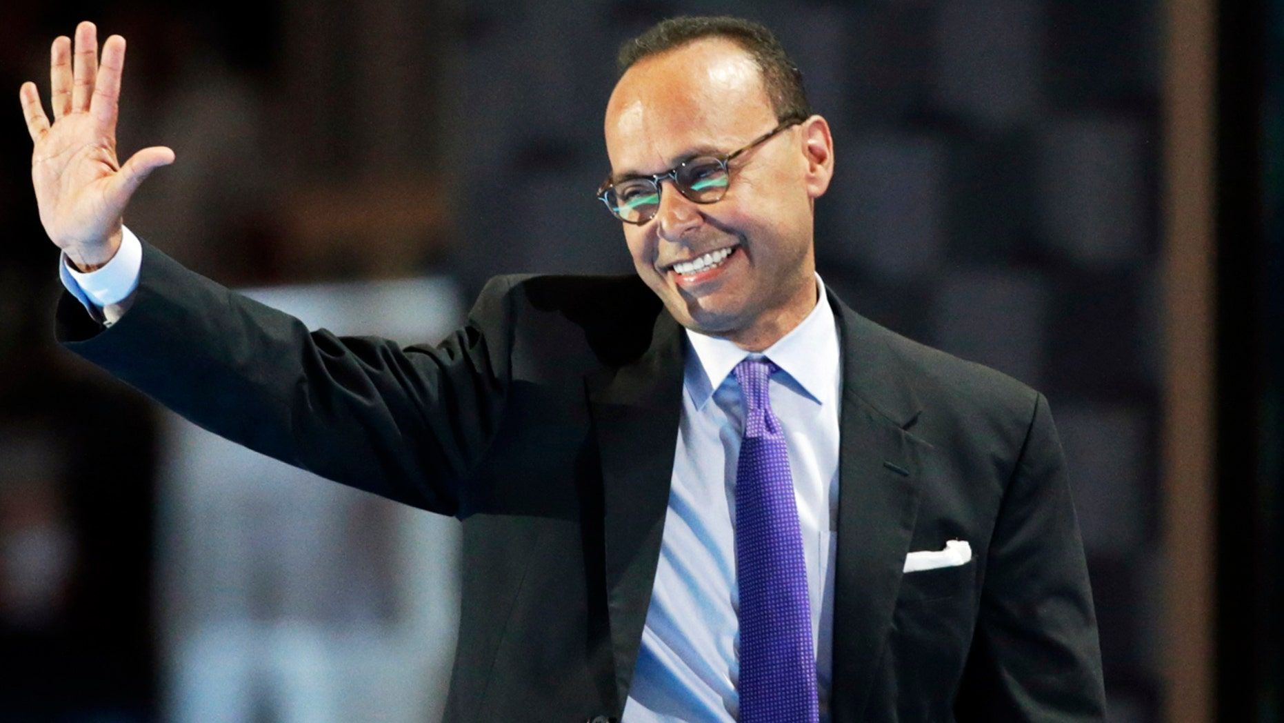 U.S. Rep. Luis Gutierrez, R-Ill, waves after speaking at the Democratic National Convention in Philadelphia in July 2016..