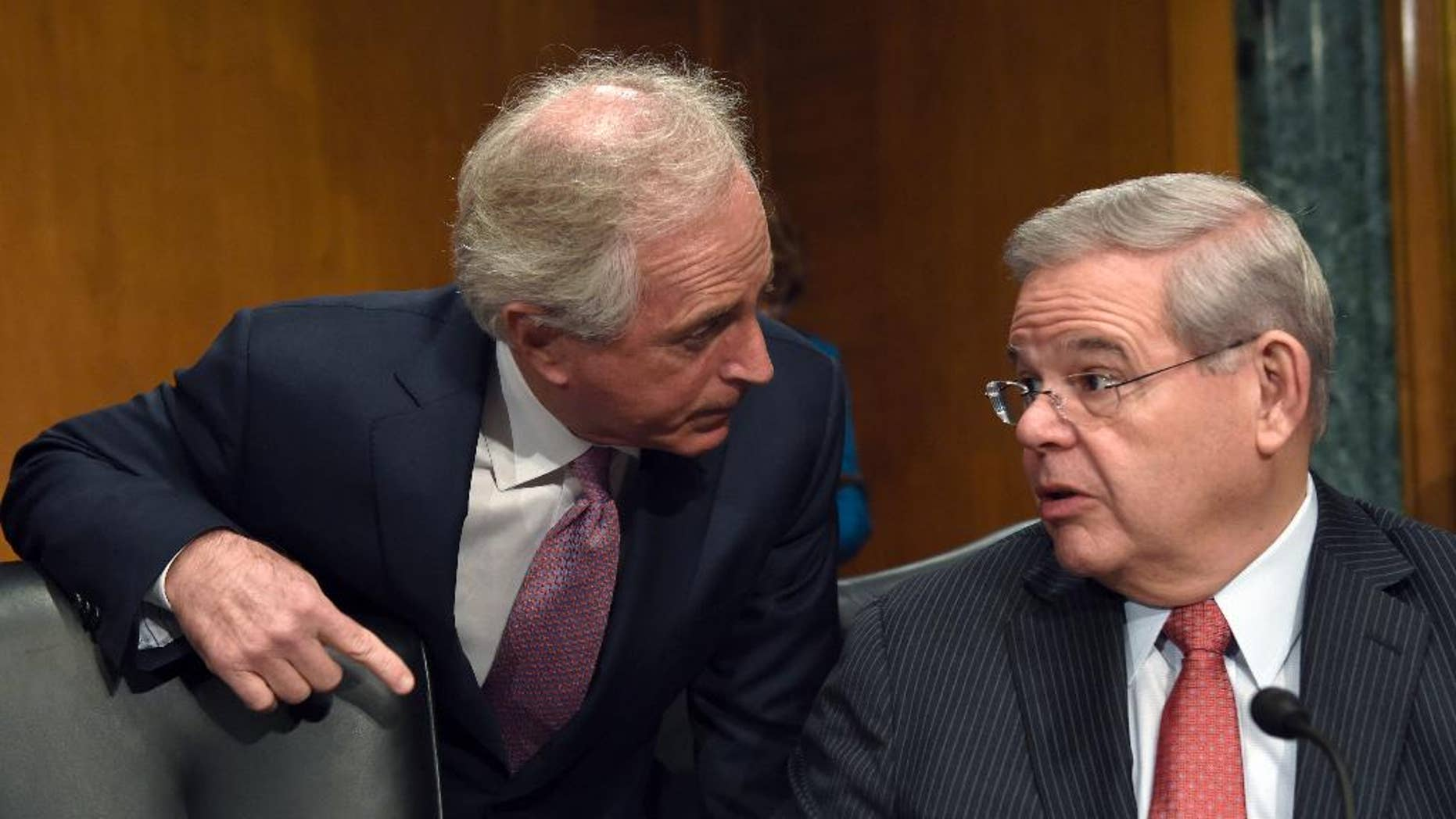 FILE - In this Jan. 27, 2015 file photo, Senate Foreign Relations Committee Chairman Sen. Bob Corker, R-Tenn., left, talks with the committee's tanking member Sen. Robert Menendez, D-N.J. on Capitol Hill in Washington. A bill calling for Congress to have a say about an emerging nuclear agreement with Iran has turned into a tug of war on Capitol Hill with Republicans trying to raise the bar so high that a final deal might be impossible and Democrats aiming to give the White House more room to negotiate with Tehran. Democratic and GOP senators are considering more than 50 amendments to a controversial bill introduced by Corker and Menendez. The bill would restrict Obama's ability to ease sanctions against Iran without congressional approval.(AP Photo/Susan Walsh, File)