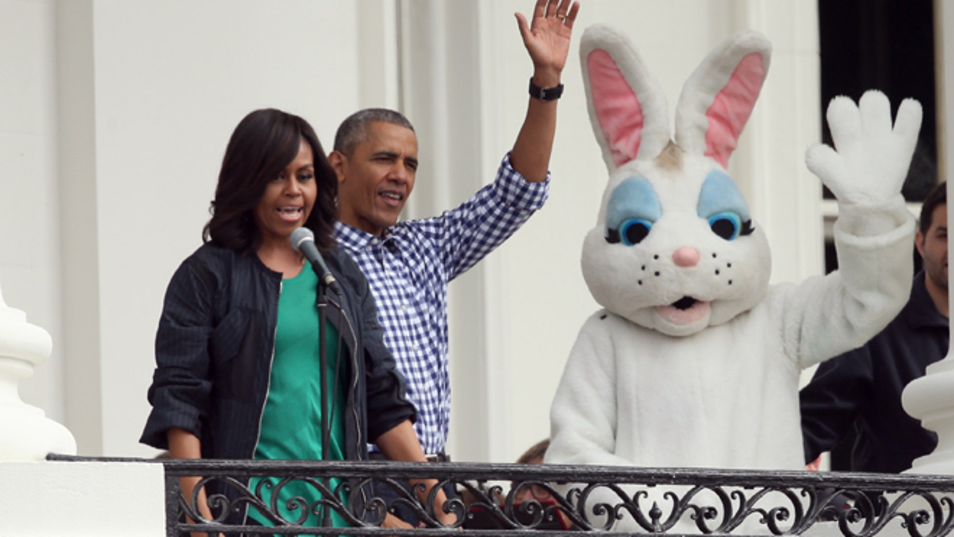 Mar. 28, 2016: President Barack Obama, accompanied by first lady Michelle Obama and the Easter Bunny wave from the Truman Balcony of the White House in Washington to participants on the South Lawn during the annual White House Easter Egg roll.