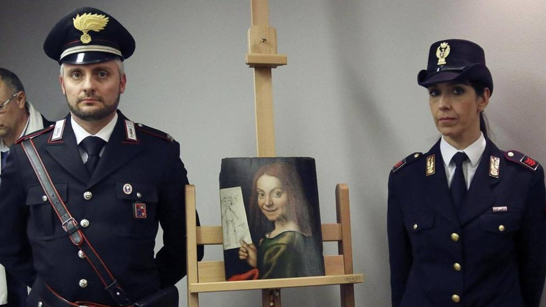 Carabinieri and police officers pose with one of the recovered paintings that were stolen from a Verona museum, at the Verona airport in Italy.