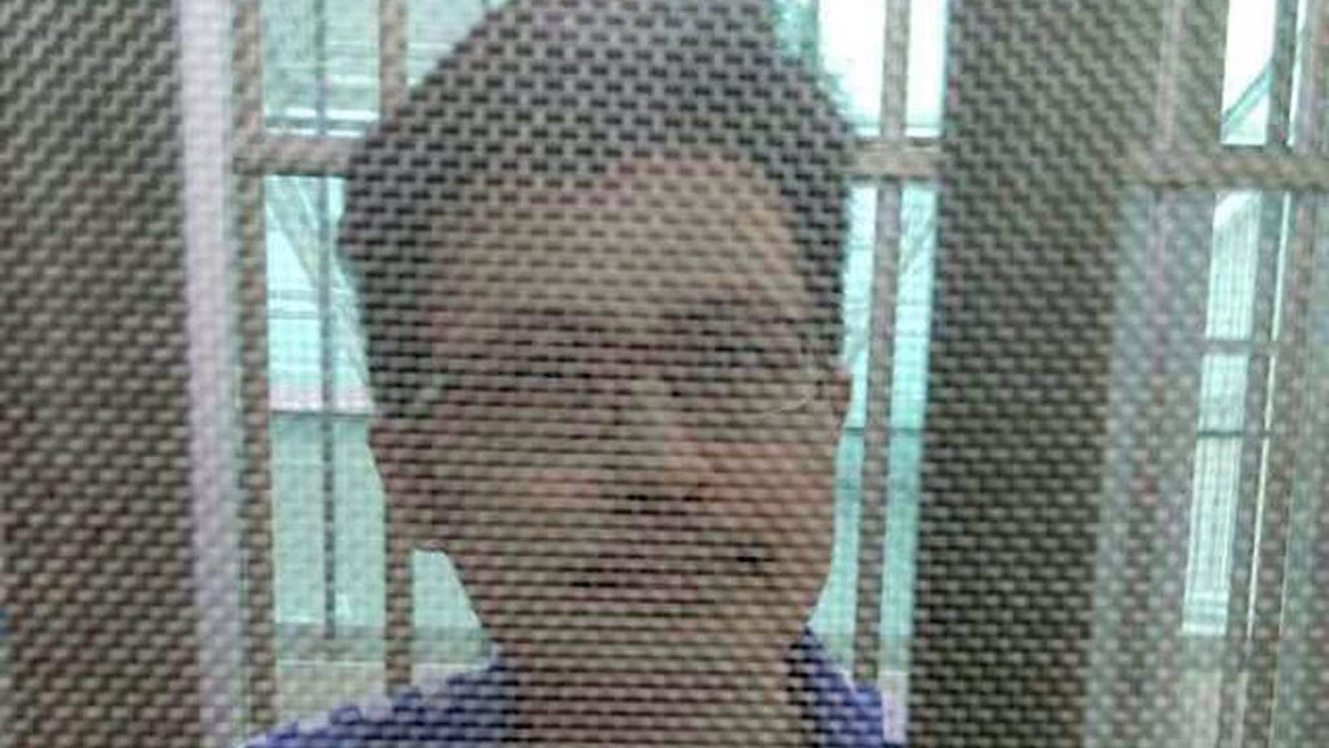 In this December 2014 photo, Yang Maodong, better known by his penname Guo Feixiong, sits in a detention center in Guangzhou in southern China's Guangdong province. The sister of a prominent imprisoned Chinese political activist said Friday, May 6, 2016, that she fears her brother is seriously ill and is urging the authorities to allow him access to better medical treatment, in what an international rights group said is the latest example of China routinely denying political prisoners adequate care. (AP Photo) NO SALES