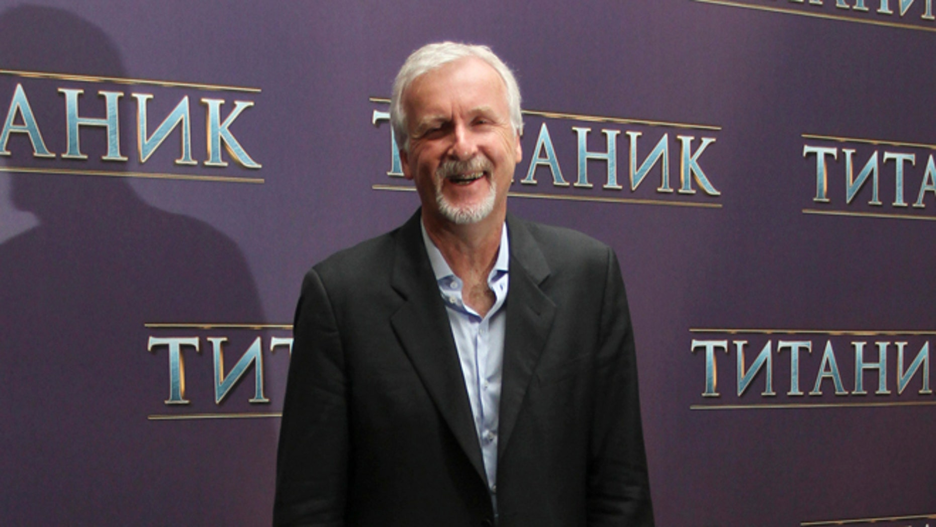 """U.S. film director James Cameron poses for a photograph during a presentation for the media in Moscow March 29, 2012. Cameron is visiting the Russian capital to promote his film """"Titanic 3D"""".  REUTERS/Ivan Burnyashev (RUSSIA - Tags: ENTERTAINMENT)"""