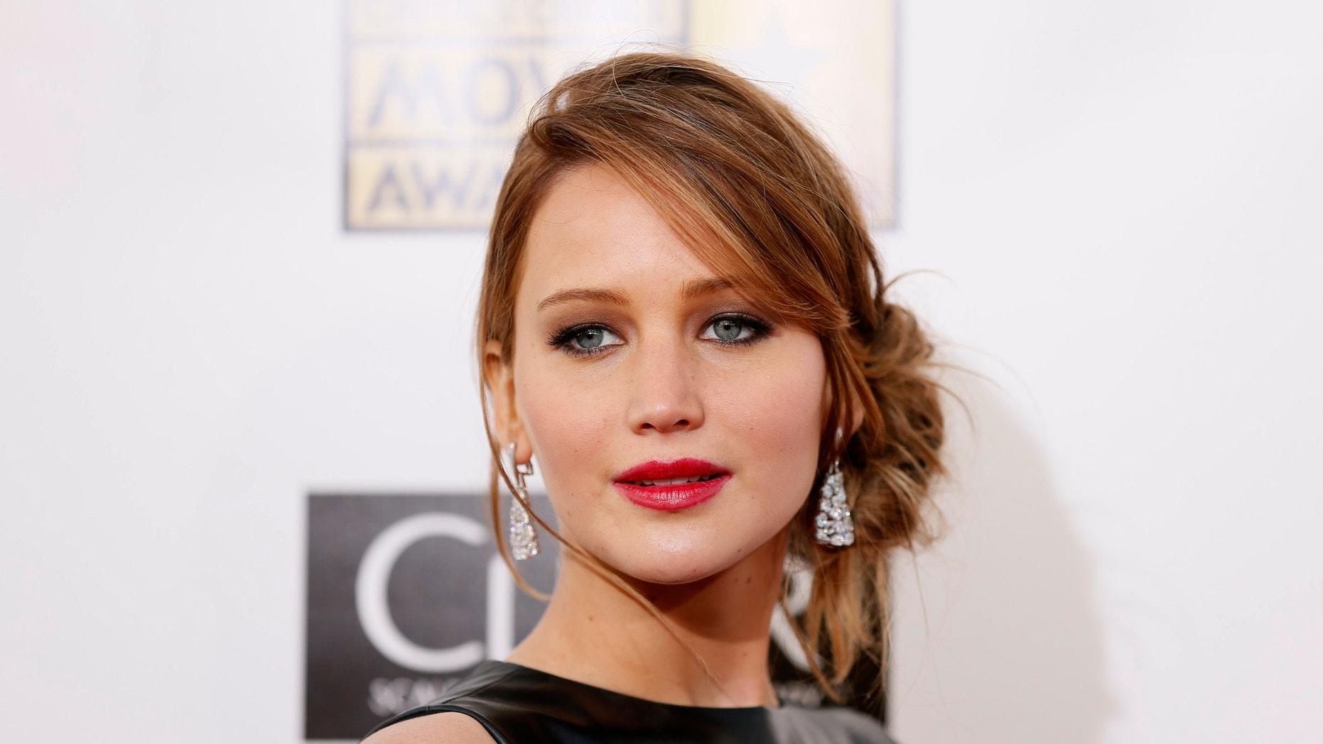 Jennifer Lawrence poses on arrival at the 2013 Critics' Choice Awards in Santa Monica, California January 10, 2013.