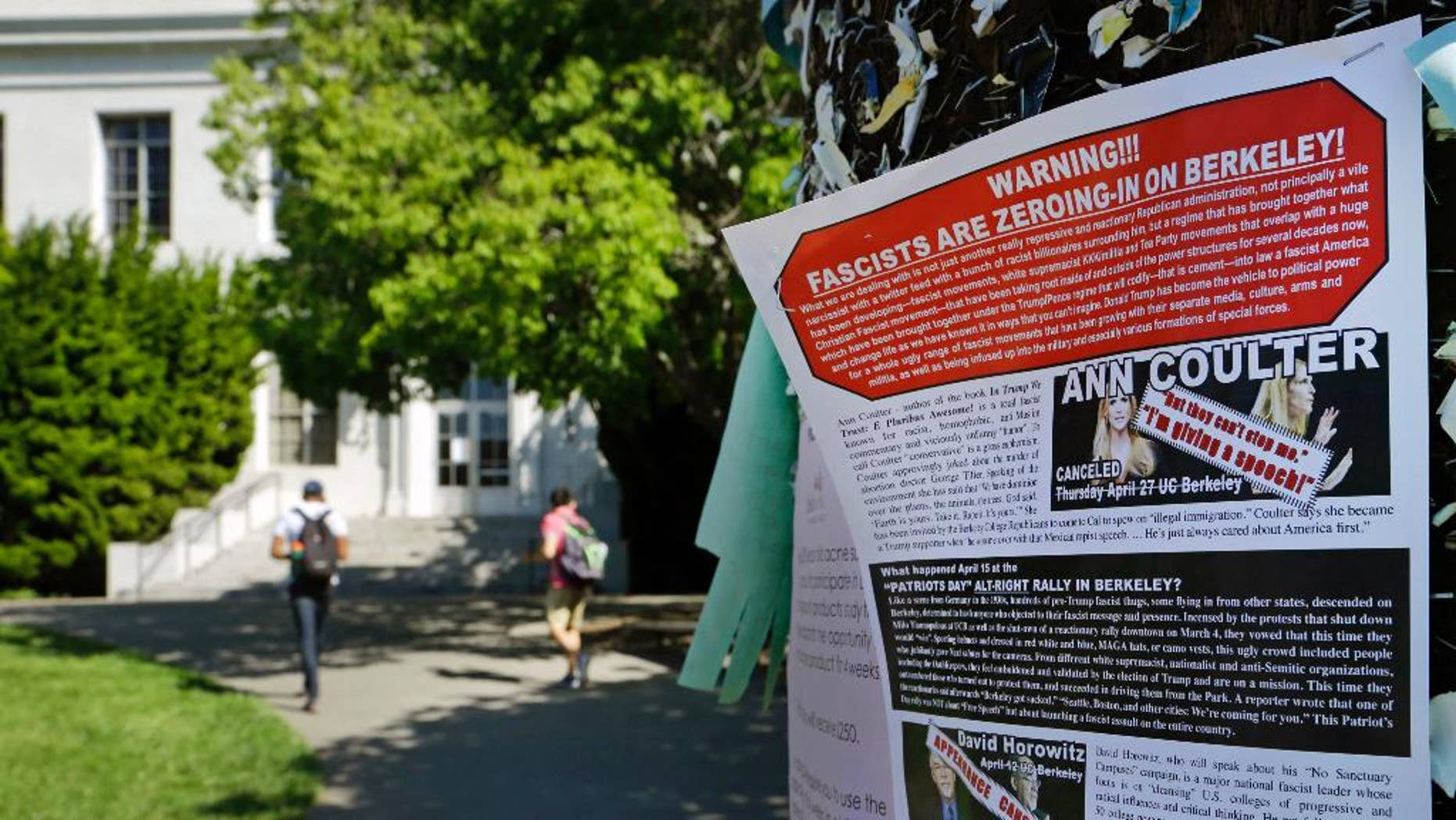 FILE - In this Friday, April 21, 2017, file photo, a leaflet is seen stapled to a message board near Sproul Hall on the University of California at Berkeley in Berkeley, Calif. The University of California, Berkeley says it's preparing for possible violence on campus whether Ann Coulter comes to speak or not. (AP Photo/Ben Margot, File)