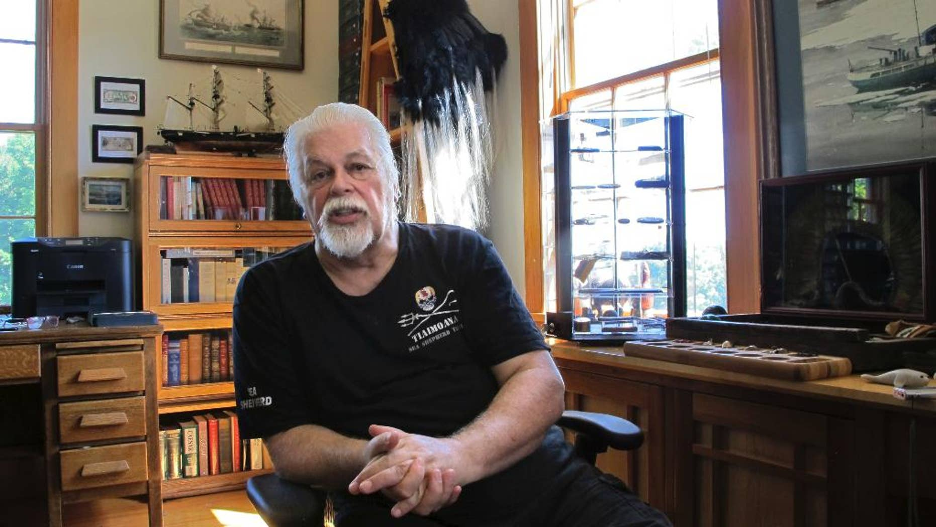 "In this Aug. 23, 2016 photo, Paul Watson, founder of the Sea Shepherd Conservation Society, made famous by the television show ""Whale Wars"" discusses a recent legal battle over anti-whaling activities, at his home office in Woodstock, Vt. Japan's Institute of Cetacean Research and a whale ship operator announced this week they'd reached an agreement with Sea Shepherd Conservation Society over those anti-whaling activities. Watson said the settlement only prevents the group's U.S. organization from interfering with Japanese whalers in the Southern Ocean. (AP Photo/Lisa Rathke)"