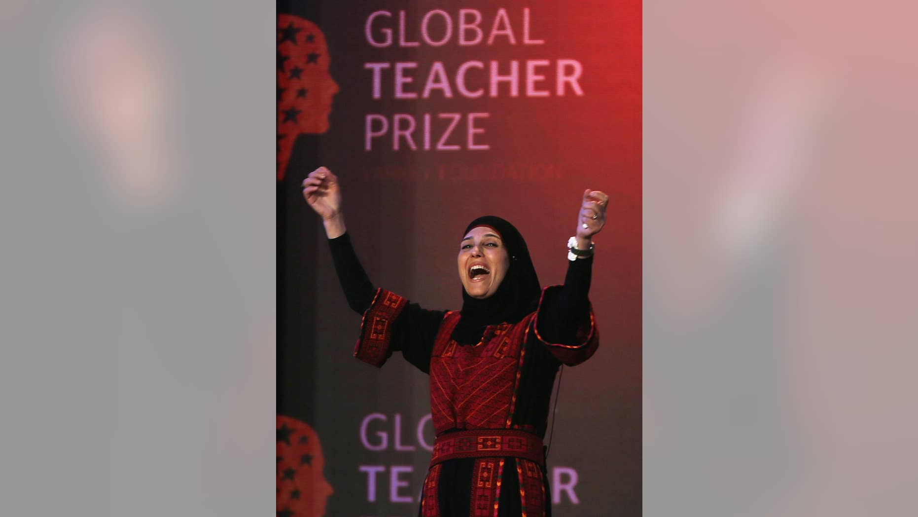 FILE - In this Sunday, March 13, 2016 file photo, Palestinian primary school teacher Hanan al-Hroub reacts after she won the second annual Global Teacher Prize, in Dubai, United Arab Emirates. The U.K.-based foundation that awarded a al-Hroub a $1 million prize for preaching nonviolence is sticking by its choice following revelations that the woman's husband participated in an attack that killed six Israelis three decades ago. (AP Photo/Kamran Jebreili, File)