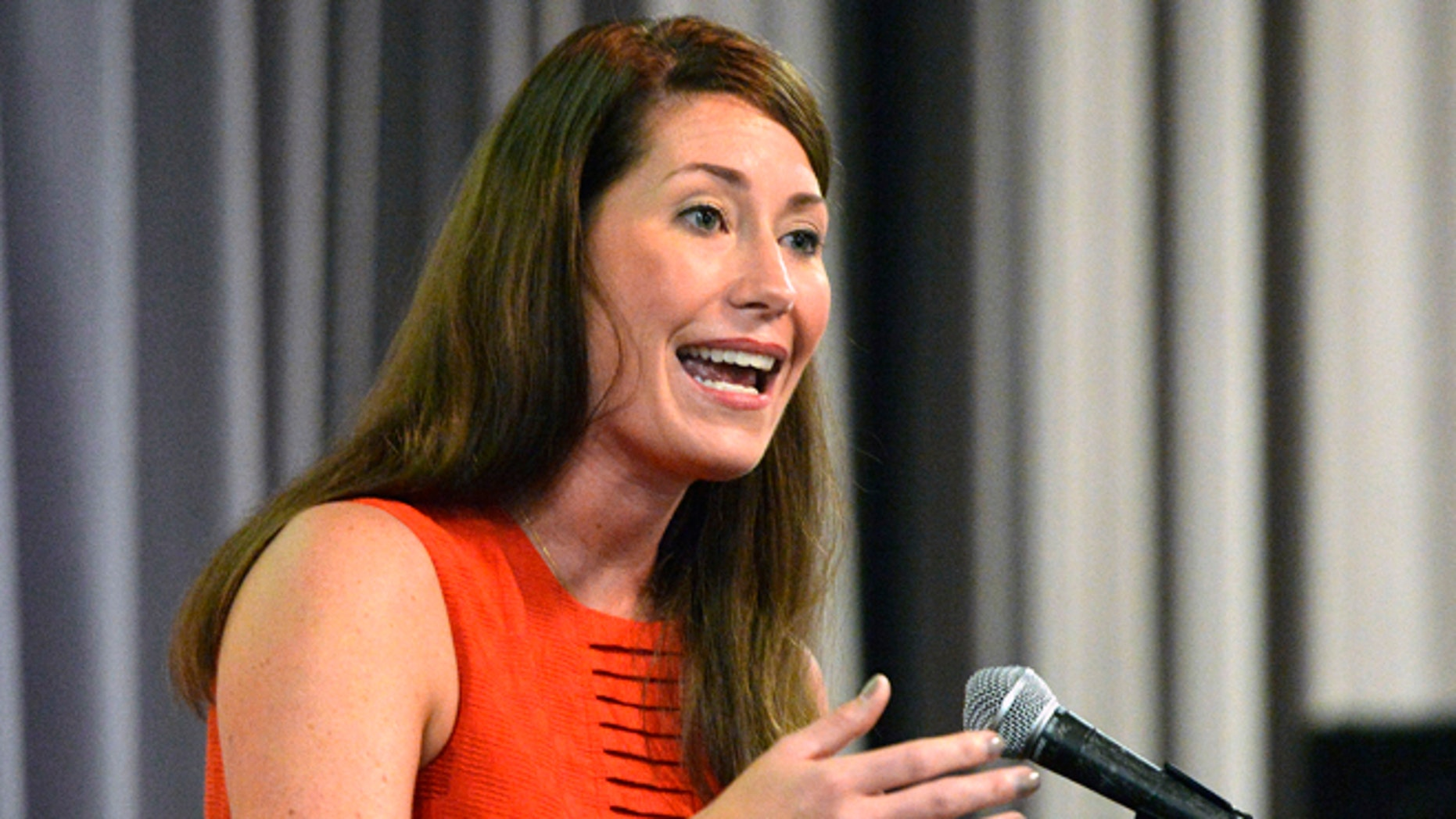 In this June 29, 2014 file photo, Kentucky democratic Senatorial candidate Alison Lundergan Grimes speaks at a rally on the University of Louisville campus in Louisville, Ky.