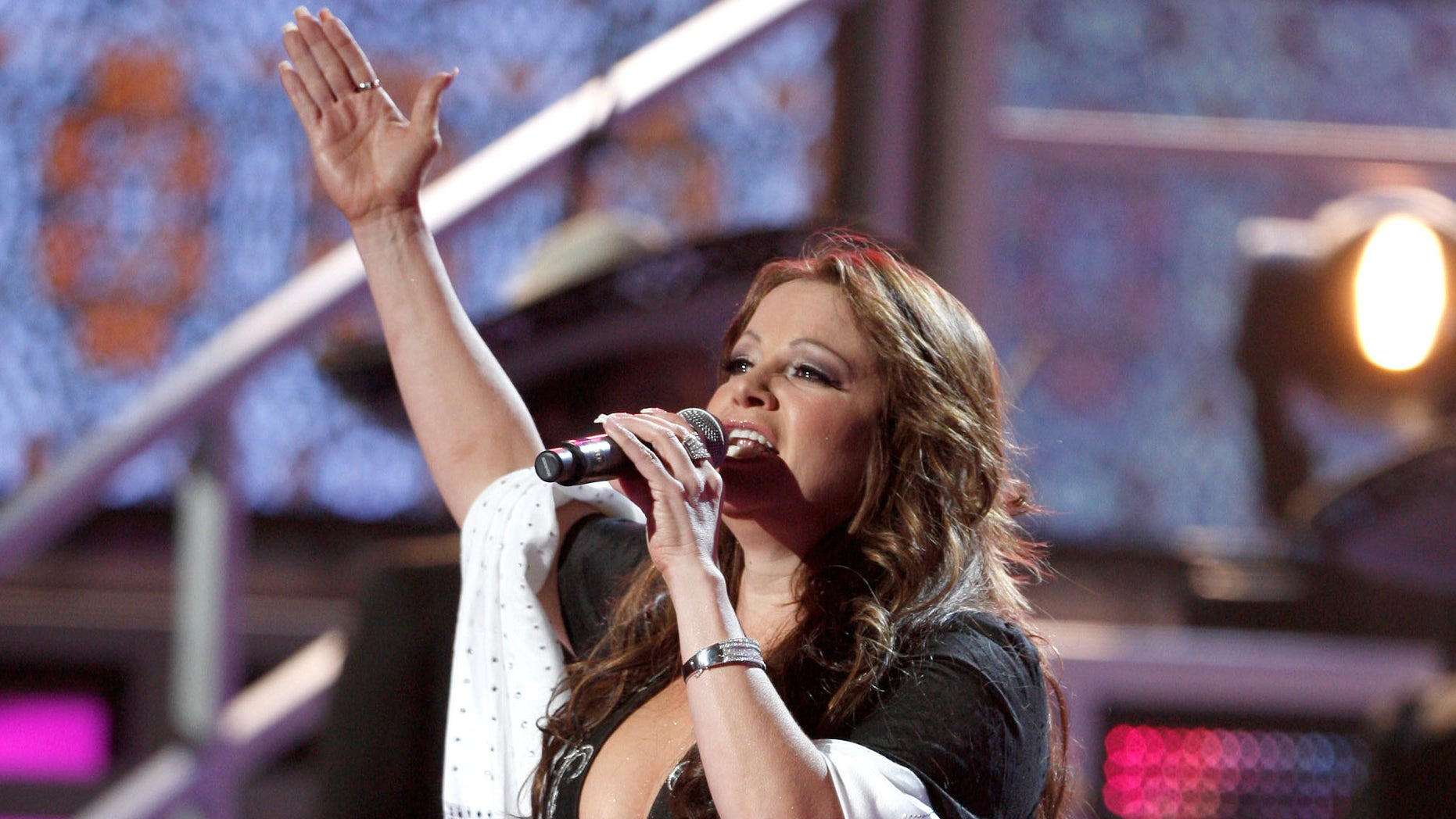HOUSTON - NOVEMBER 13:  Singer Jenni Rivera performs onstage during the 9th annual Latin GRAMMY awards held at the Toyota Center on November 13, 2008 in Houston, Texas.  (Photo by Kevin Winter/Getty Images)