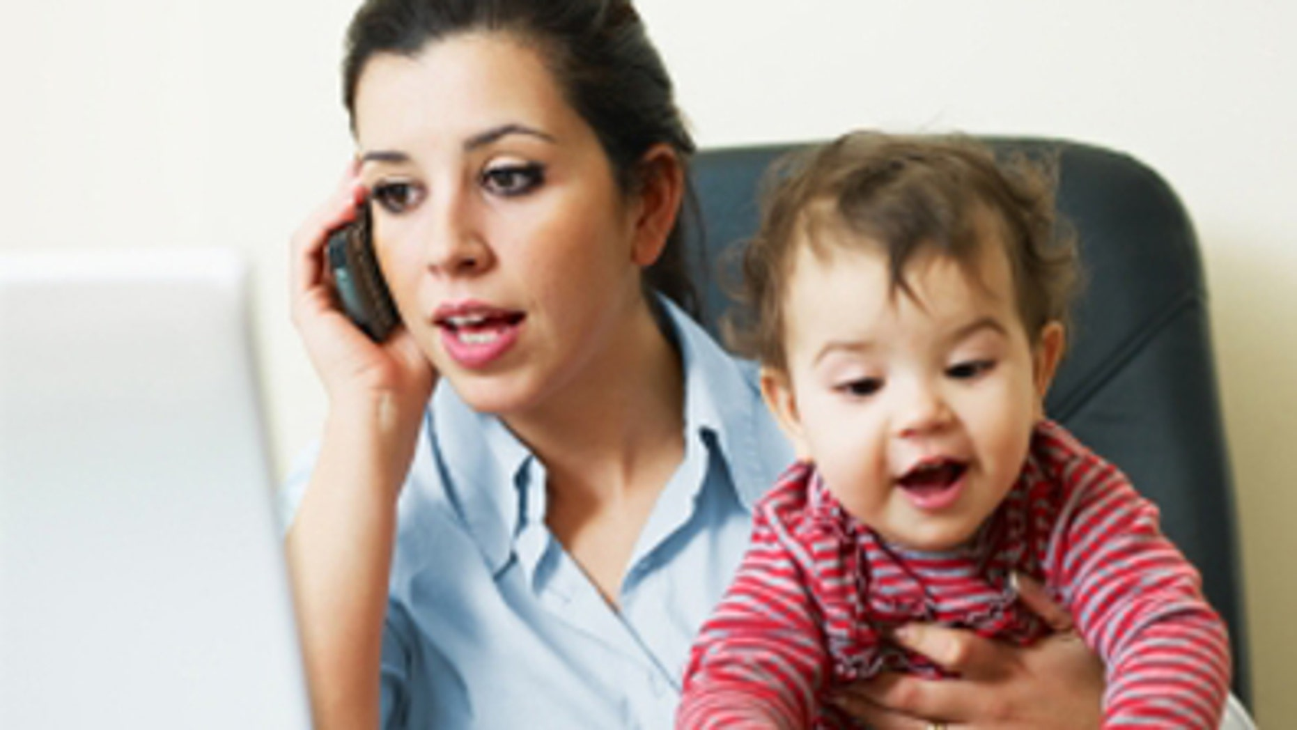 stressed business woman in office, holding her little girl while talking on mobile phone. Vertical shape, Copy space