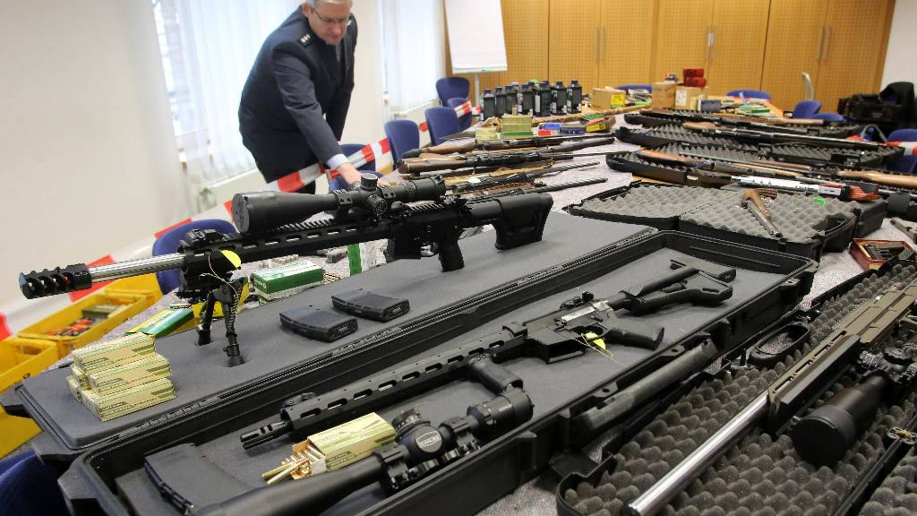 Police display weapons seized already on Nov. 9,  2016  in Solingen , Germany from the radical rightwing 'Reichsbuerger' group, in Wuppertal, Germany,  Thursday Nov. 17, 2016.  The weapons   had previously been in the possession of two members of the anti-government  organization. (RolandWeihrauch/dpa vis AP)
