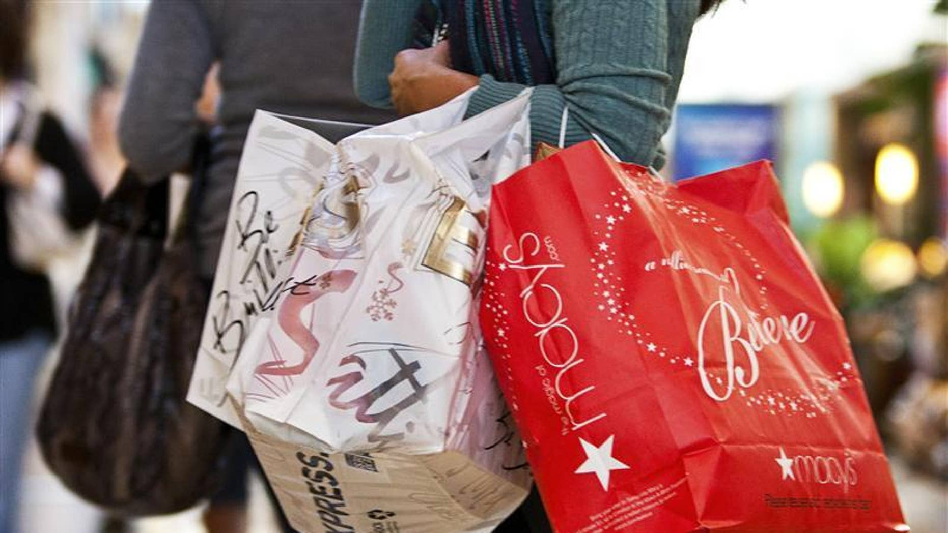 A consumer carries shopping bags in a mall in Charlotte, North Carolina