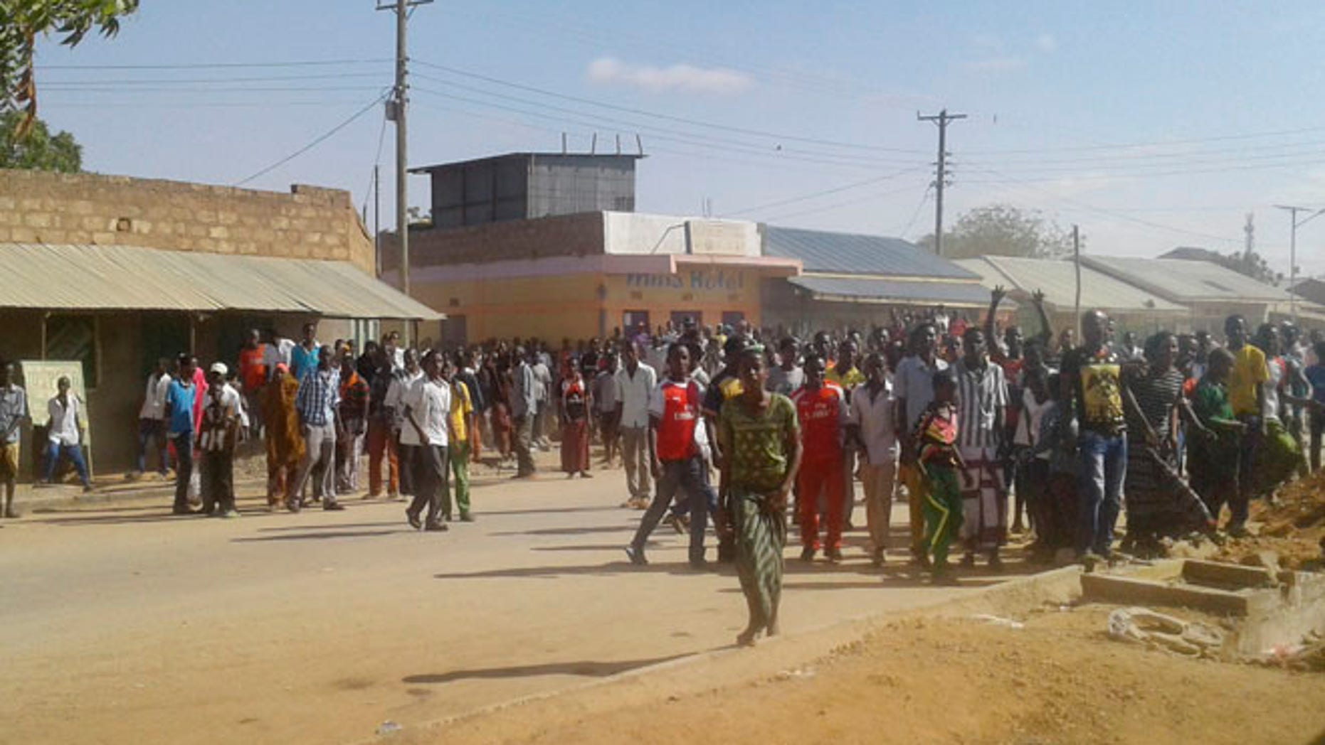 Oct. 25: Residents gather near the scene of an attack in the town of Mandera, Kenya, near the border with Somalia,