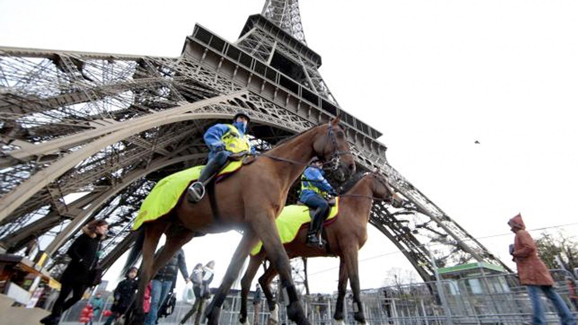 Police keep watch at Paris' Eiffel Tower.