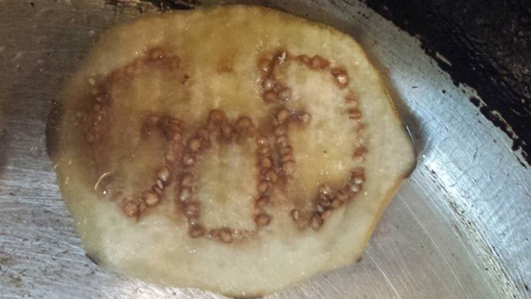 Jermarcus Brady was stunned after cutting into an eggplant to find the word GOD formed by the seeds.