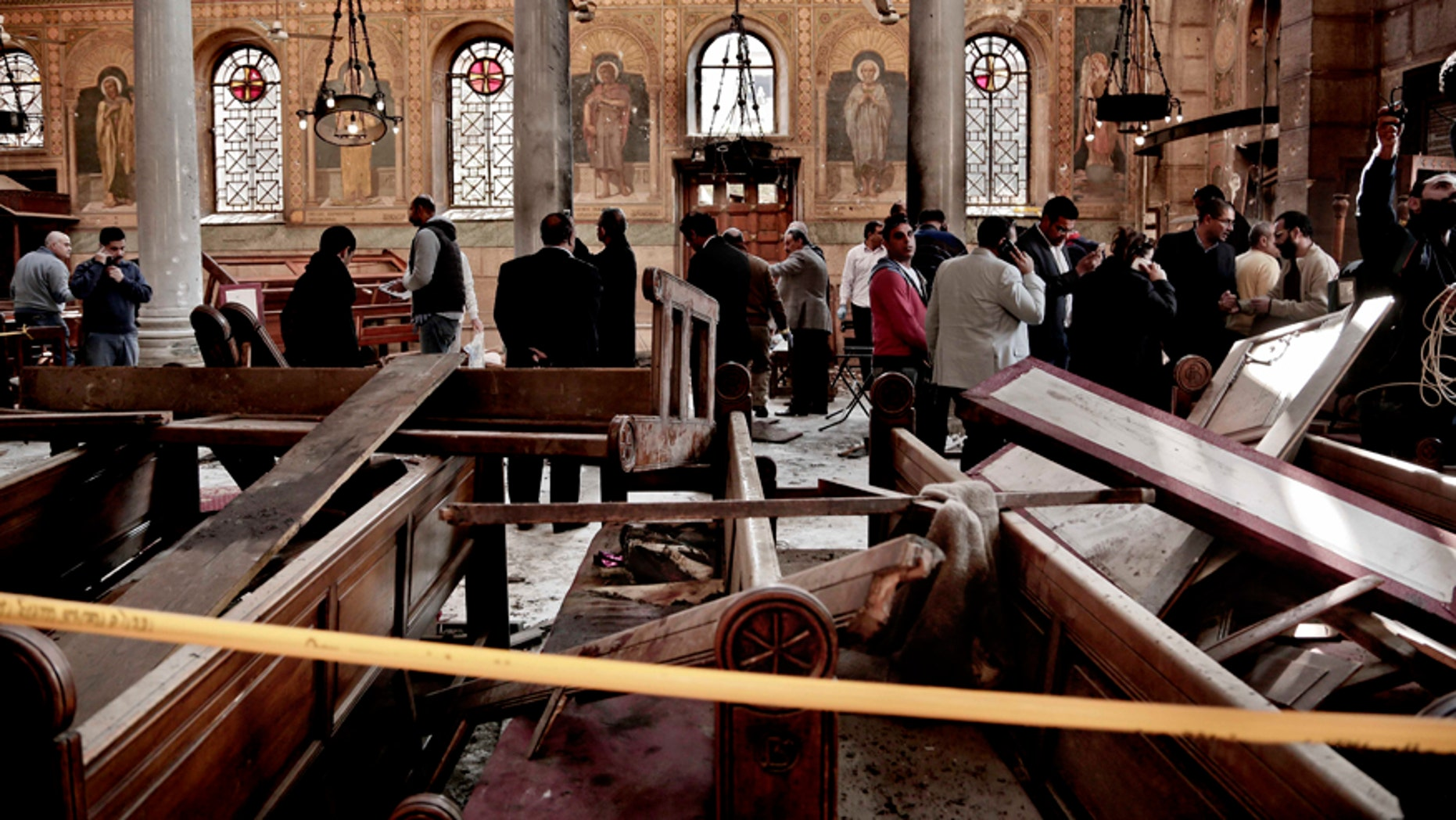 In this Dec. 11, 2016 file photo, security forces examine the scene inside the St. Mark Cathedral in central Cairo, following a bombing that killed dozens of people.