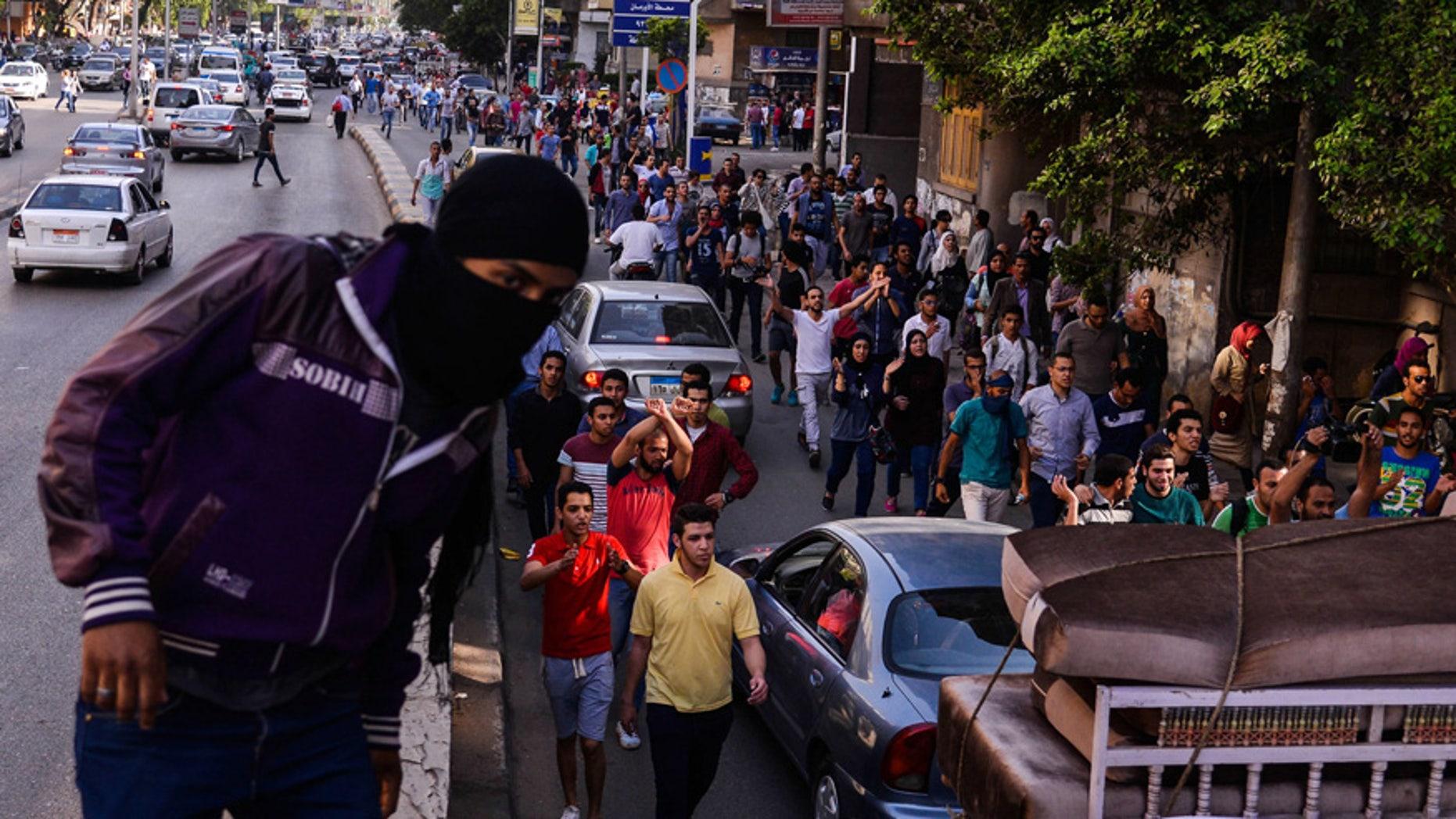 April 25, 2016: Egyptians demonstrate against President Abdel-Fattah el-Sissi in Mesaha square in Cairo's Dokki district.
