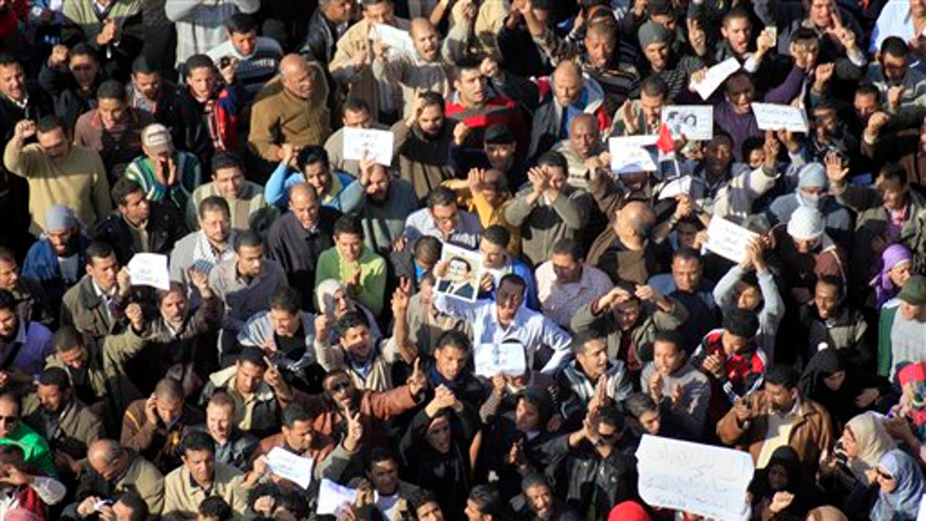 Sunday: Some of the thousands of Egyptian protesters shout anti-Mubarak slogans during a protest in Cairo, Egypt. The army sent hundreds more troops and armored vehicles onto the streets of Cairo and other cities but appeared to be taking little action against mass protests.