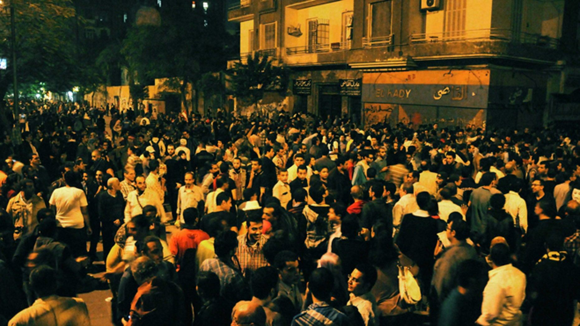 Nov. 19, 2012: Egyptian protesters gather during clashes with security forces, not pictured, in Cairo, Egypt.