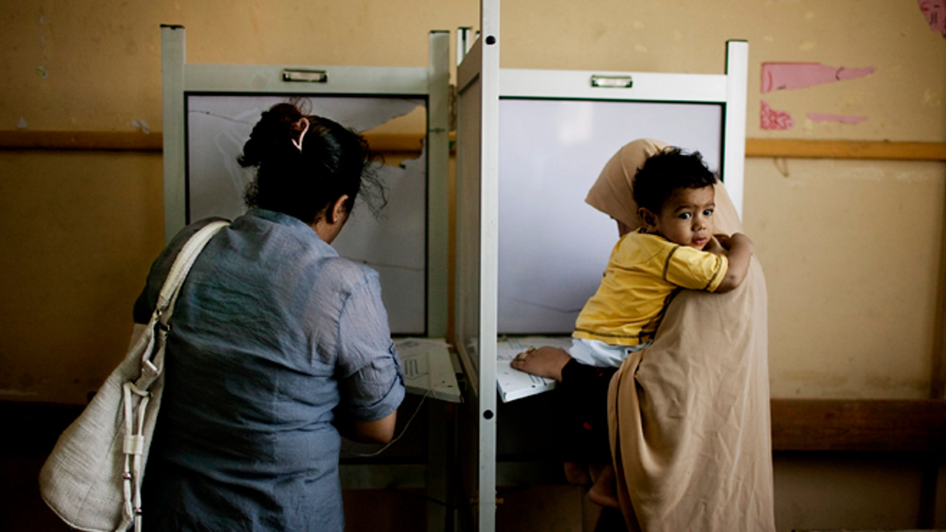 May 24, 2012: Female Egyptian voters cast their votes during the second day of presidential elections in the Mataraya neighborhood of Cairo, Egypt.