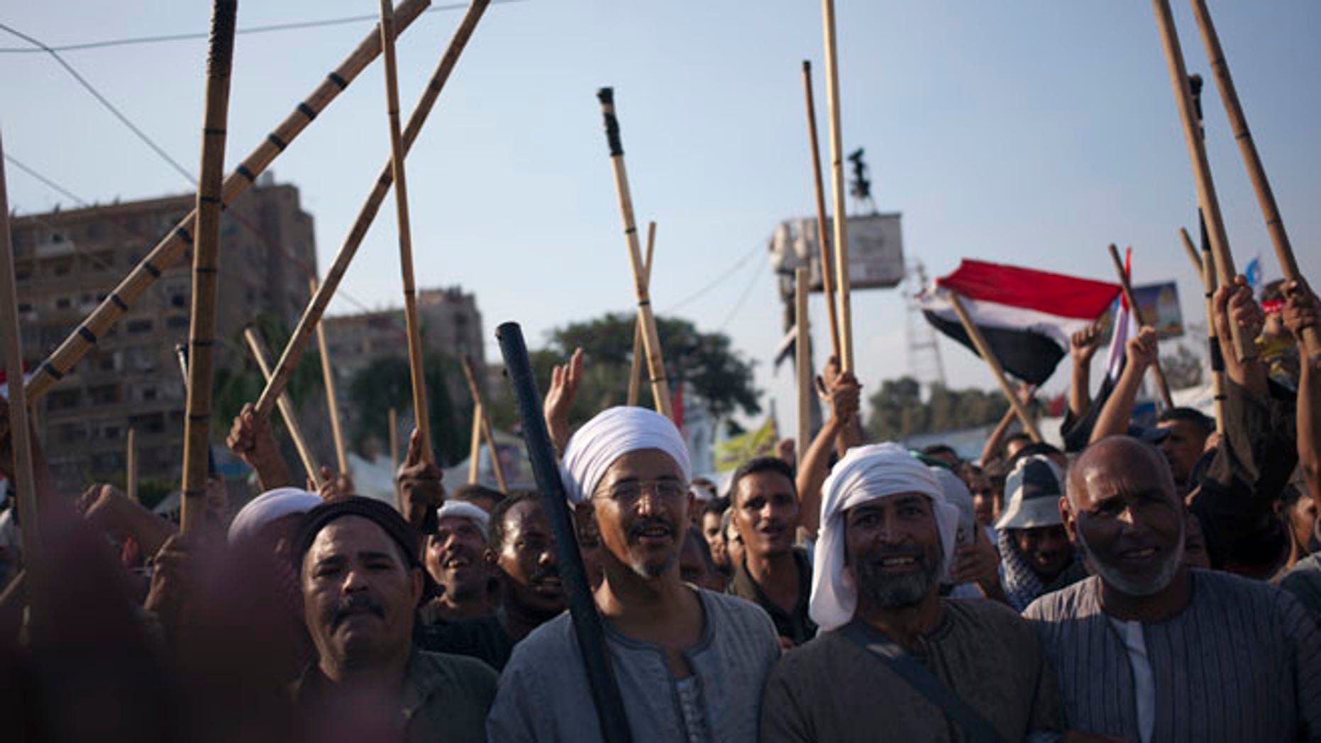 Aug. 10, 2013: Supporters of Egypt's ousted President Mohammed Morsi hold up wooden sticks as they participate in a protest outside Rabaah al-Adawiya mosque, where protesters have installed a camp and held daily rallies at Nasr City, in Cairo, Egypt.