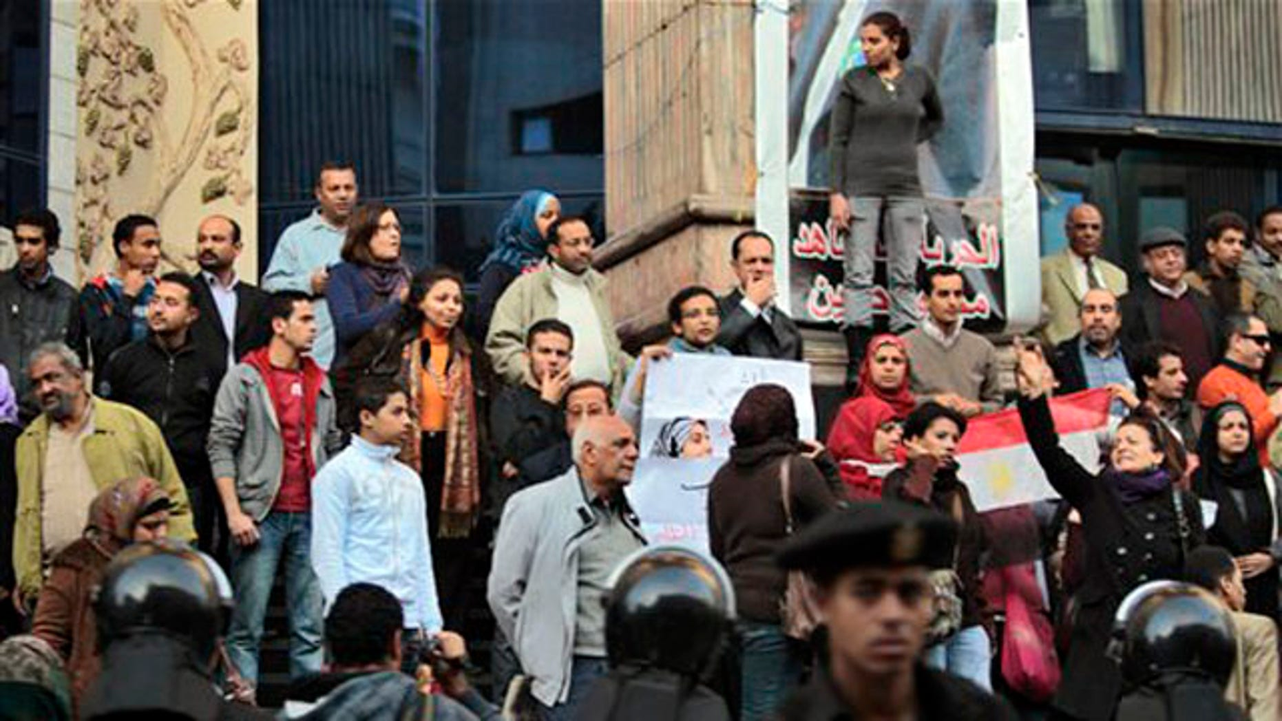 Egyptian anti-government activists chant slogans as they gather outside the Journalists Syndicate in downtown Cairo, Egypt, on Jan. 27.
