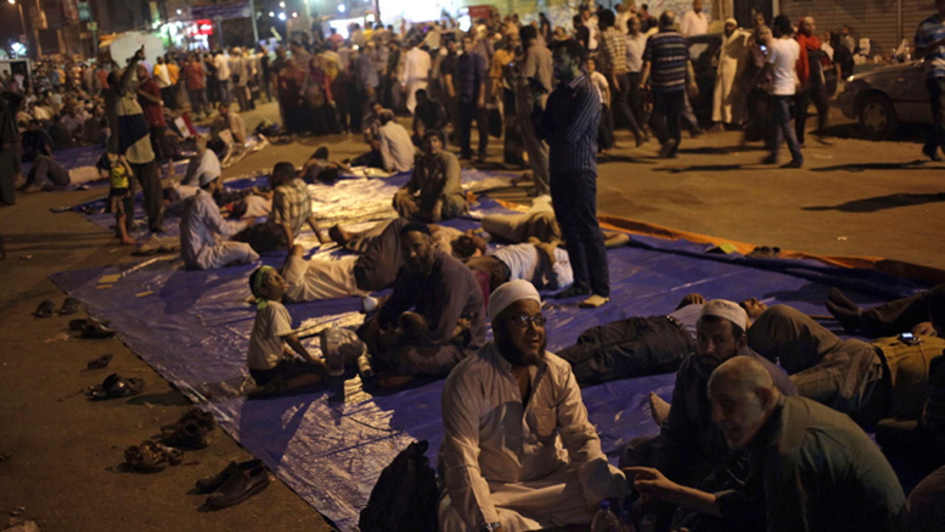 Aug. 2, 2013: Supporters of Egypt's ousted President Mohammed Morsi sit on a street as they protest near Cairo airport in Cairo, Egypt.