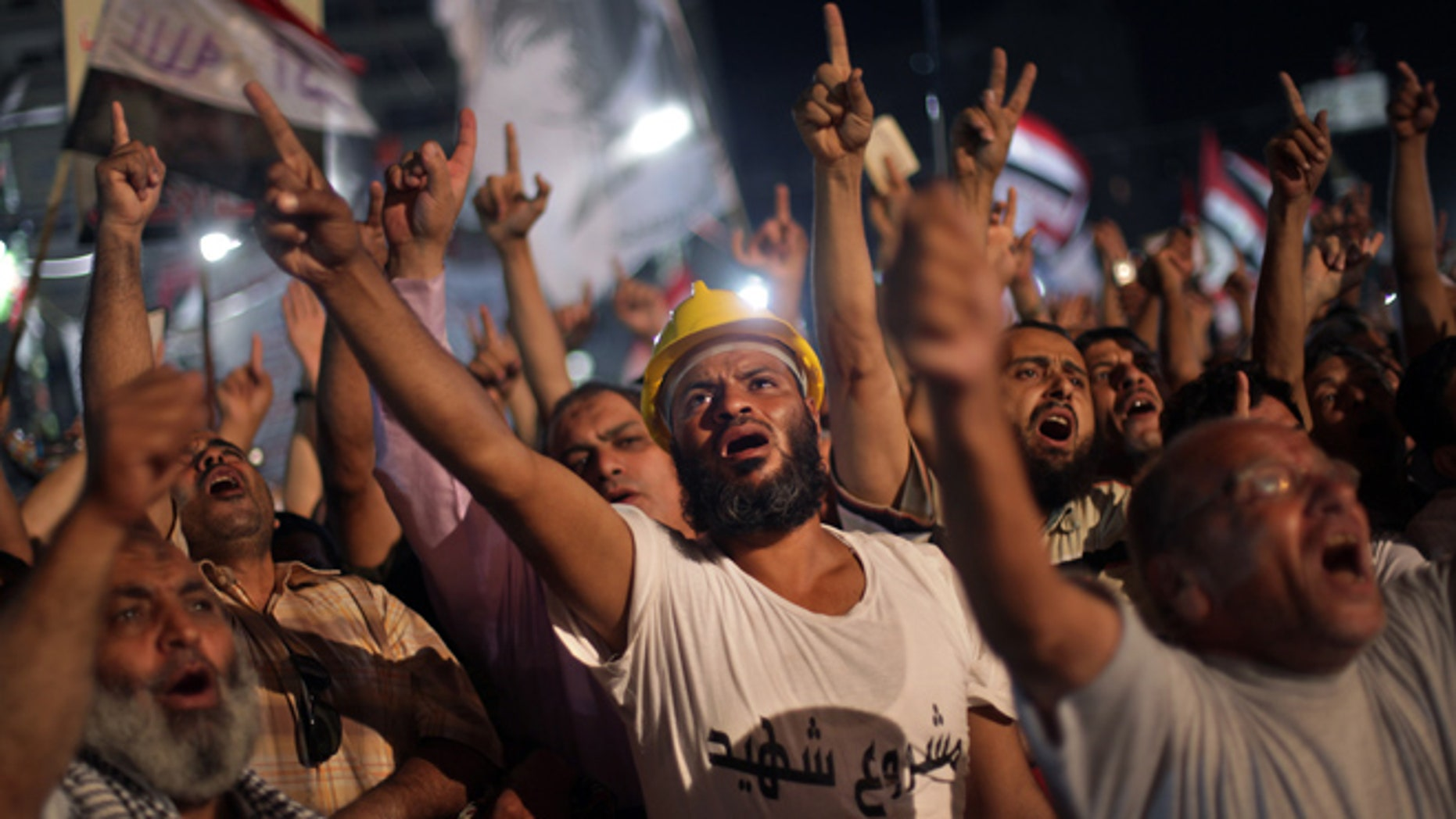 July 31, 2013: Supporters of Egypt's ousted President Mohammed Morsi chant slogans during a protest outside Rabaah al-Adawiya mosque, where they have installed a camp and hold daily rallies at Nasr City, in Cairo, Egypt, Wednesday.