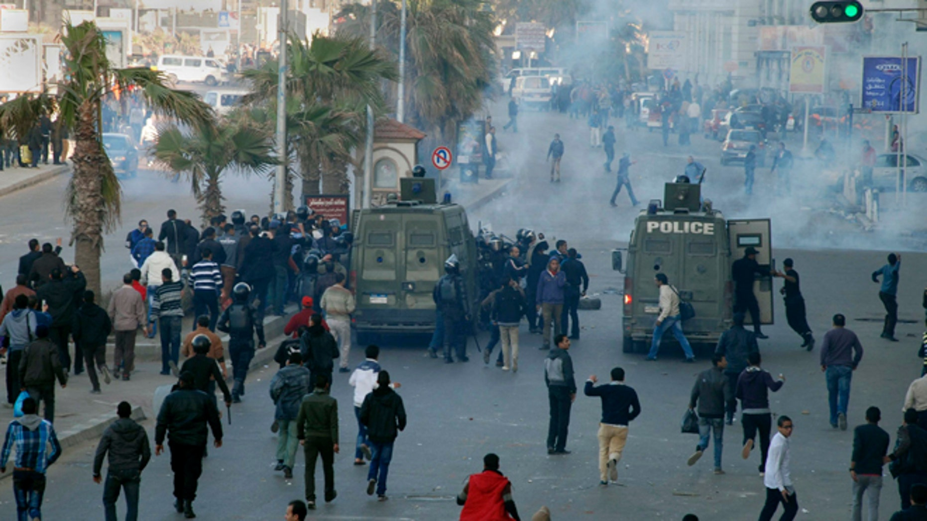 Jan. 19, 2013: Egyptian police and protesters clash outside a courtroom in Alexandria, Egypt.