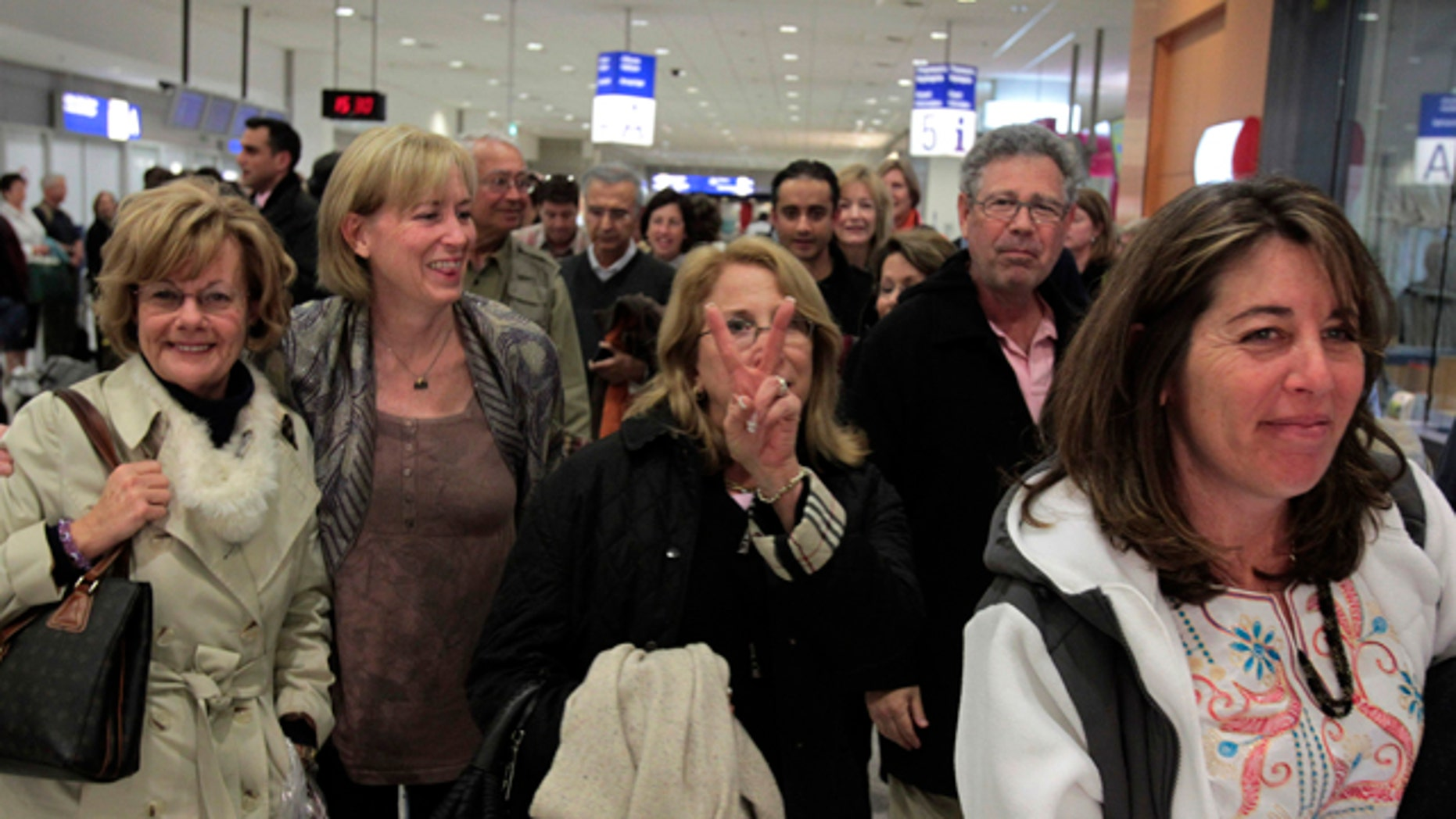Jan. 31: Tourists from the U.S. arrive at Athens International Airport Eleftherios Venizelos in Spata, near Athens. A tourist group with 65 Americans arrived in Athens as hundreds of foreigners were being evacuated from the unrest in Egypt, with countries scrambling to send planes to fly their citizens out and Cairo's short-staffed international airport a scene of chaos and confusion. (AP)