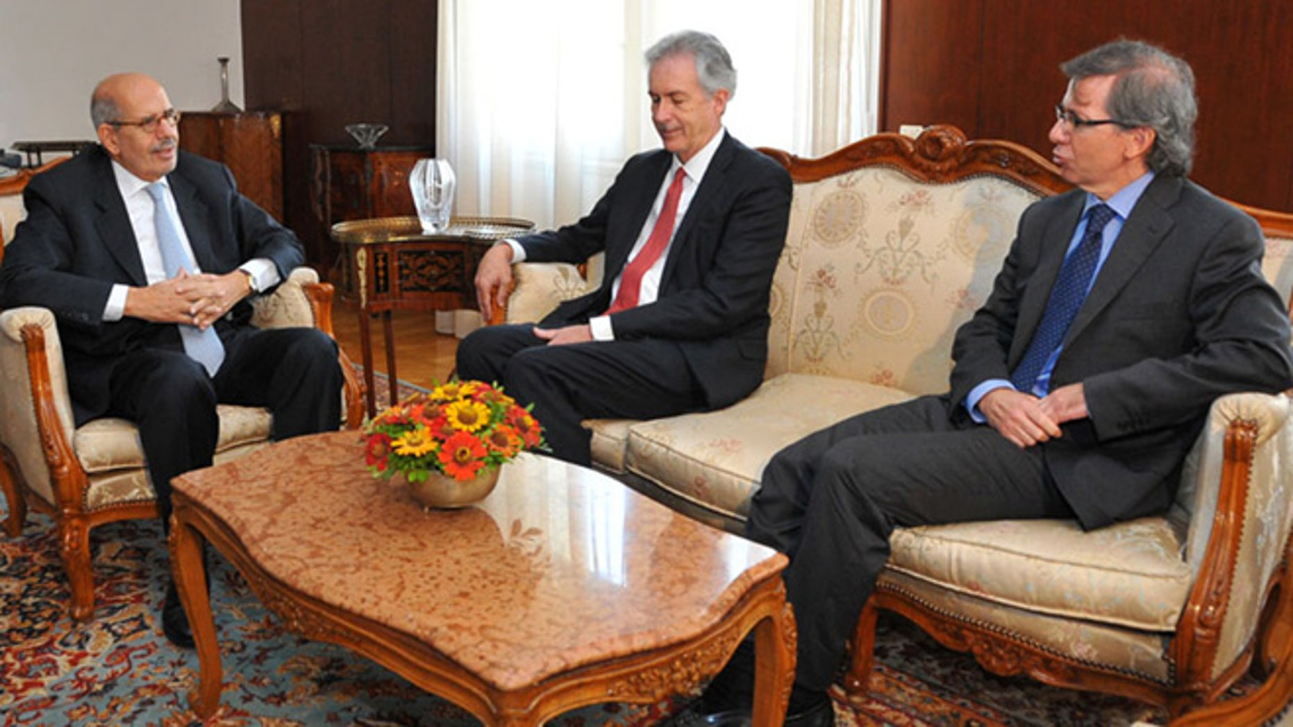 Aug. 6, 2013: This image released by the Egyptian Presidency shows interim Vice President Mohamed Elbaradei, left, meets with U.S. Deputy Secretary of State William Burns, center, in Cairo, Egypt.