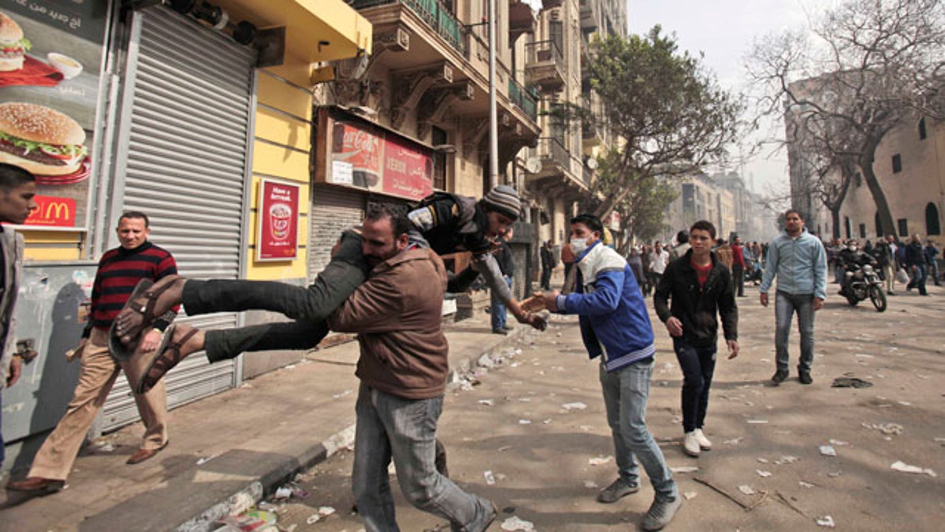 Feb. 6, 2012: An Egyptian protestor injured in clashes with security forces is carried to a field hospital during clashes near the Interior Ministry in Cairo, Egypt.