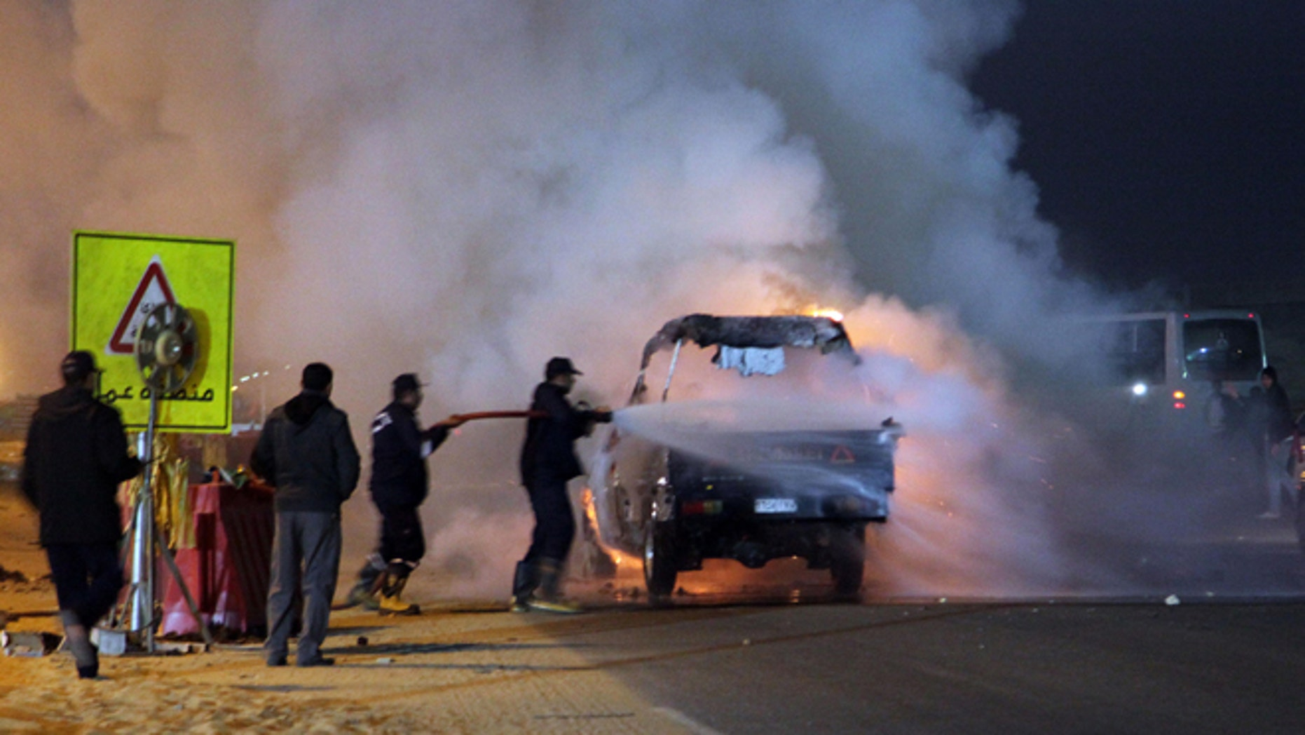 Feb. 8, 2015: Firefighters try to extinguish a fire on a truck as a riot broke out outside of a major soccer match between Egyptian Premier League clubs Zamalek and ENPPI at Air Defense Stadium in a suburb east of Cairo, Egypt, Sunday.