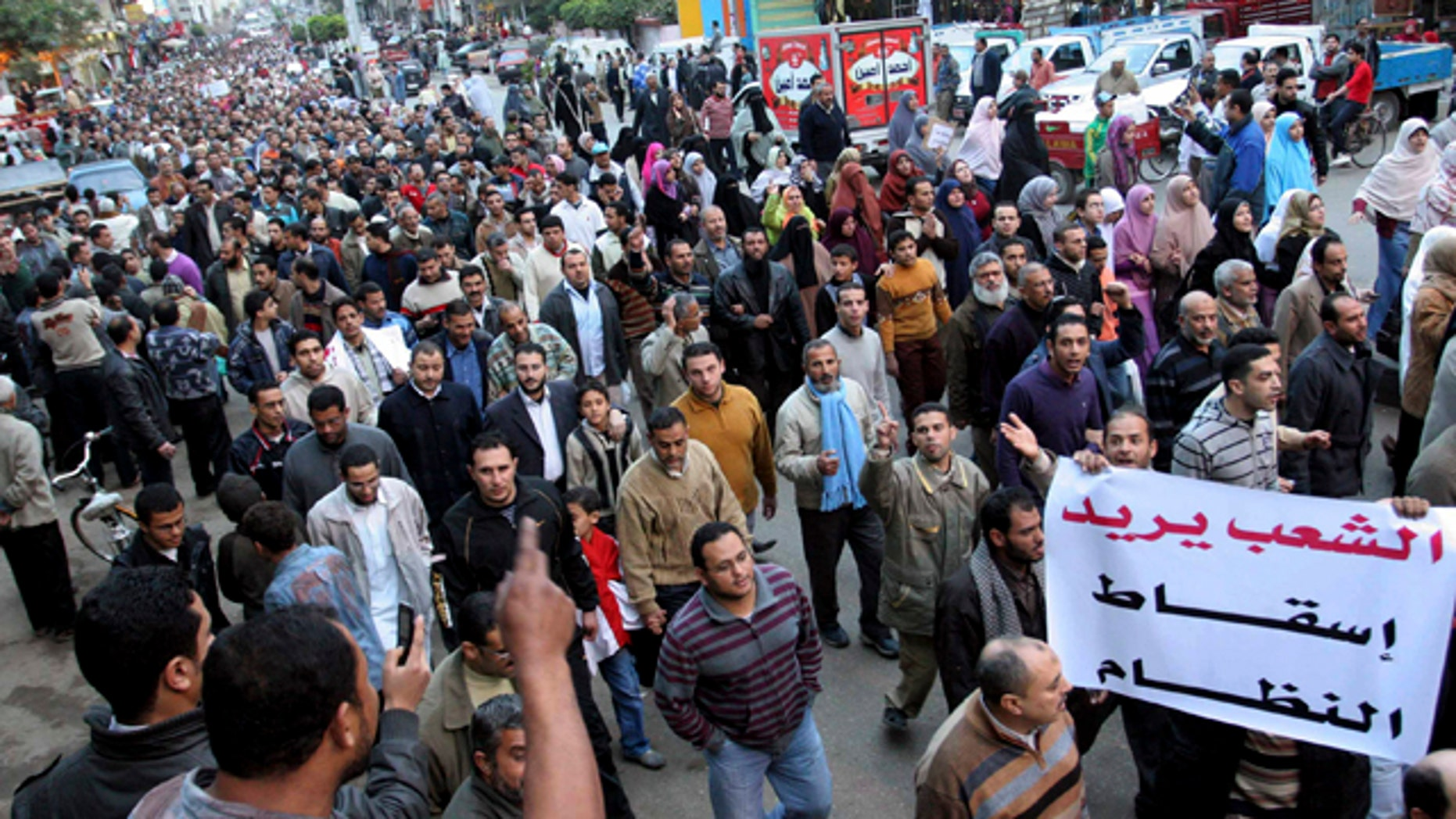 Feb. 6, 2011: Egyptian anti-Mubarak protesters march in al Mansoura city, Egypt.