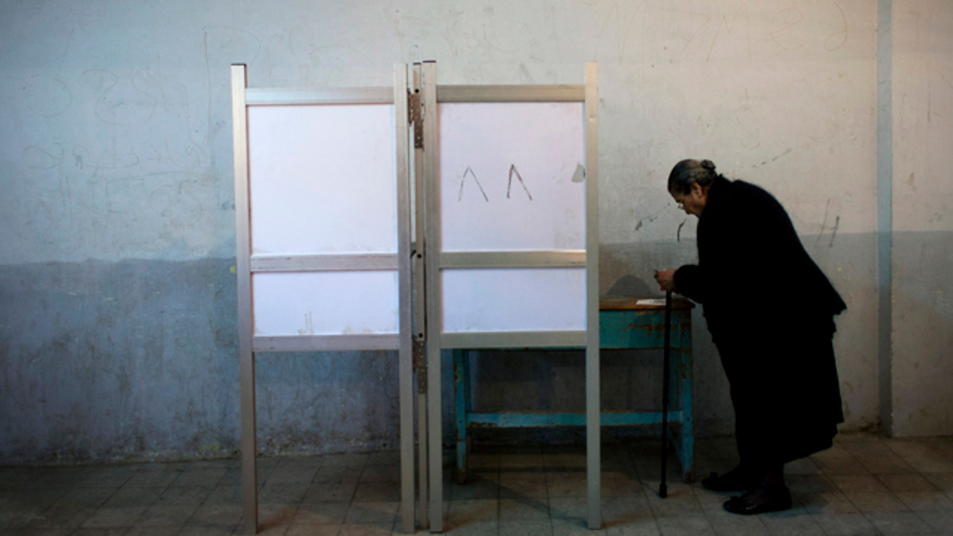 Dec. 15, 2012: An Egyptian woman votes at polling center during a referendum on a disputed constitution drafted by Islamist supporters of President Mohammed Morsi in Cairo.
