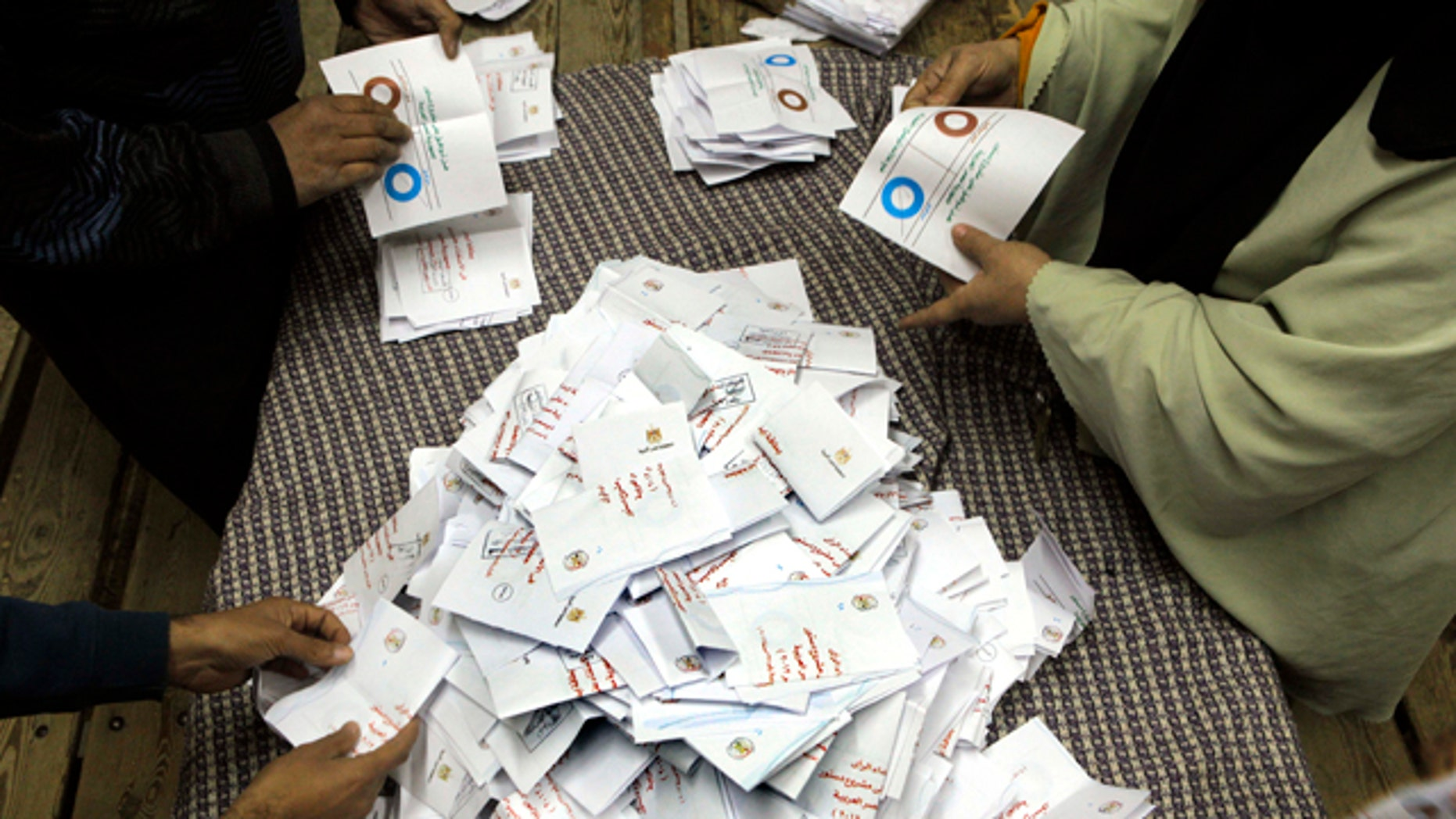 Dec. 15, 2012: Egyptian referendum officials count votes at a polling station in Cairo, Egypt.