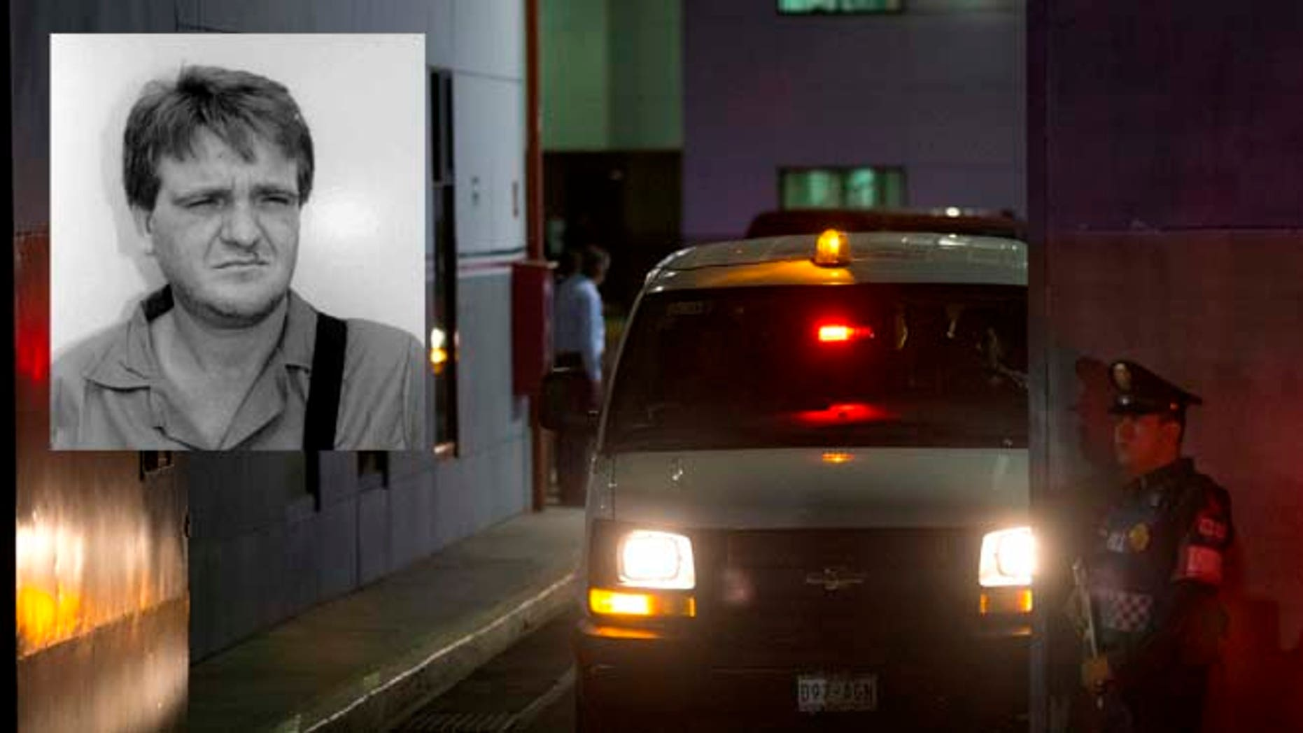 """A police officer stands guard as a vehicle leaves from the airport hangar of Mexico's Attorney General office, in Mexico City, after the arrival of drug lord Hector """"El Guero"""" Palma, Wednesday, June 15, 2016. Palma, one of the founders of the Sinaloa Cartel, returned to his native country Wednesday after serving almost a decade in a U.S. prison. U.S. authorities handed over Palma in Matamoros, across the border from Brownsville, Texas, before flying him to Mexico City for transfer to Altiplano maximum security prison.(AP Photo/Rebecca Blackwell)"""
